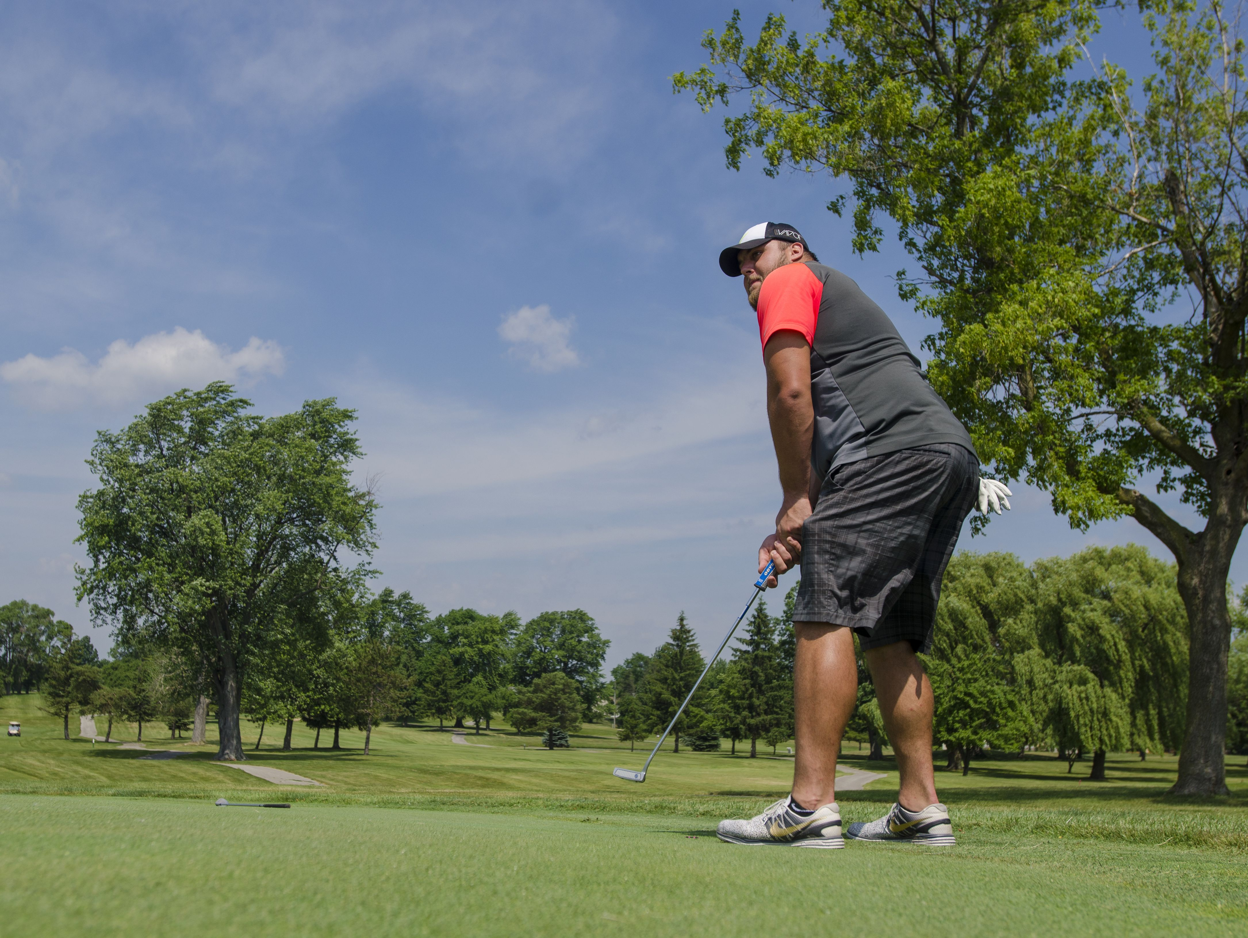 Tim Lelito watches his putt approach the hole Monday, June 20, during the Lelito Legacy Golf Outing at St. Clair Golf Cub.
