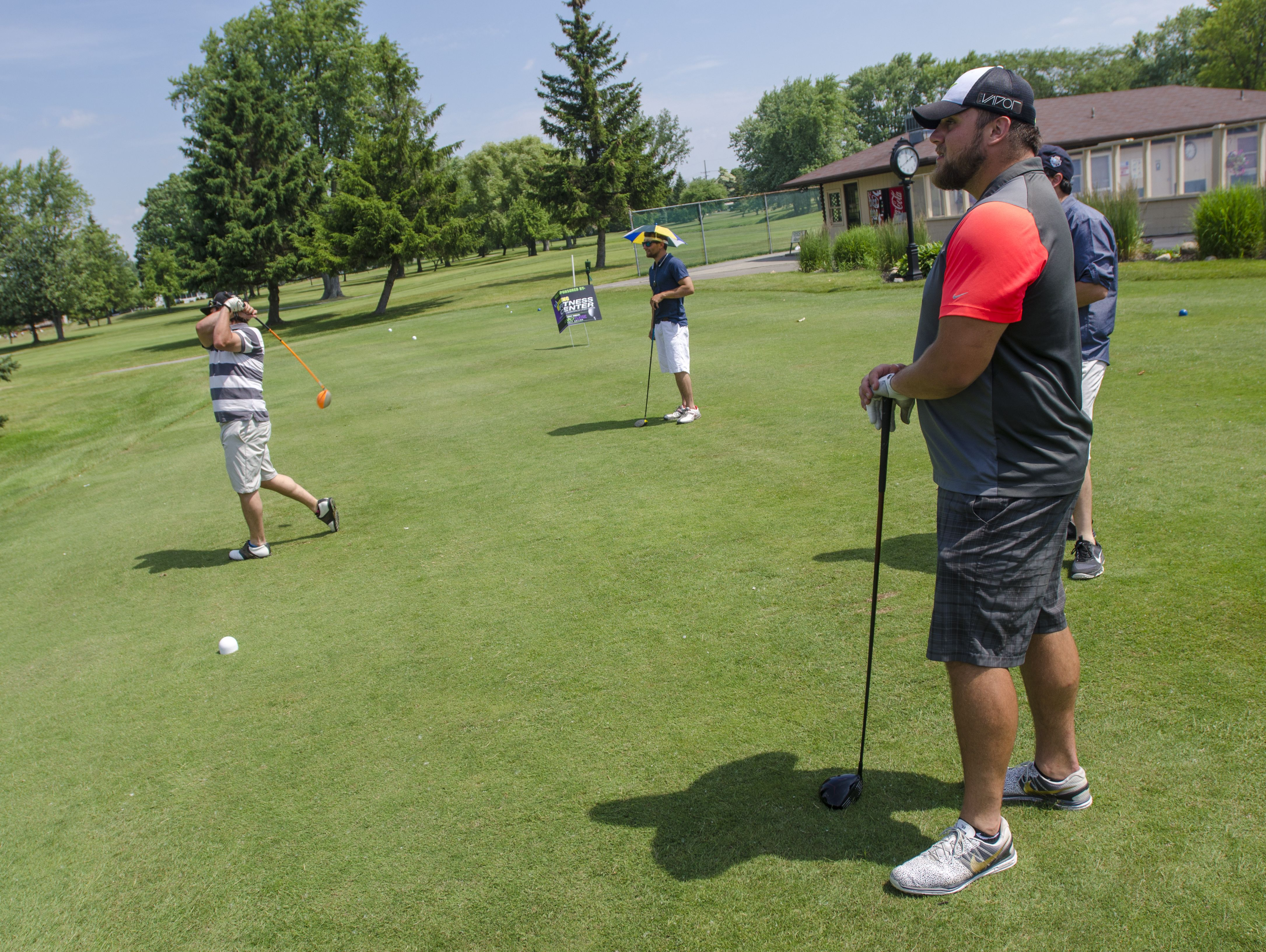 Tim Lelito and his group tee off on the 10th hole Monday, June 20, during the Lelito Legacy Golf Outing at St. Clair Golf Cub.