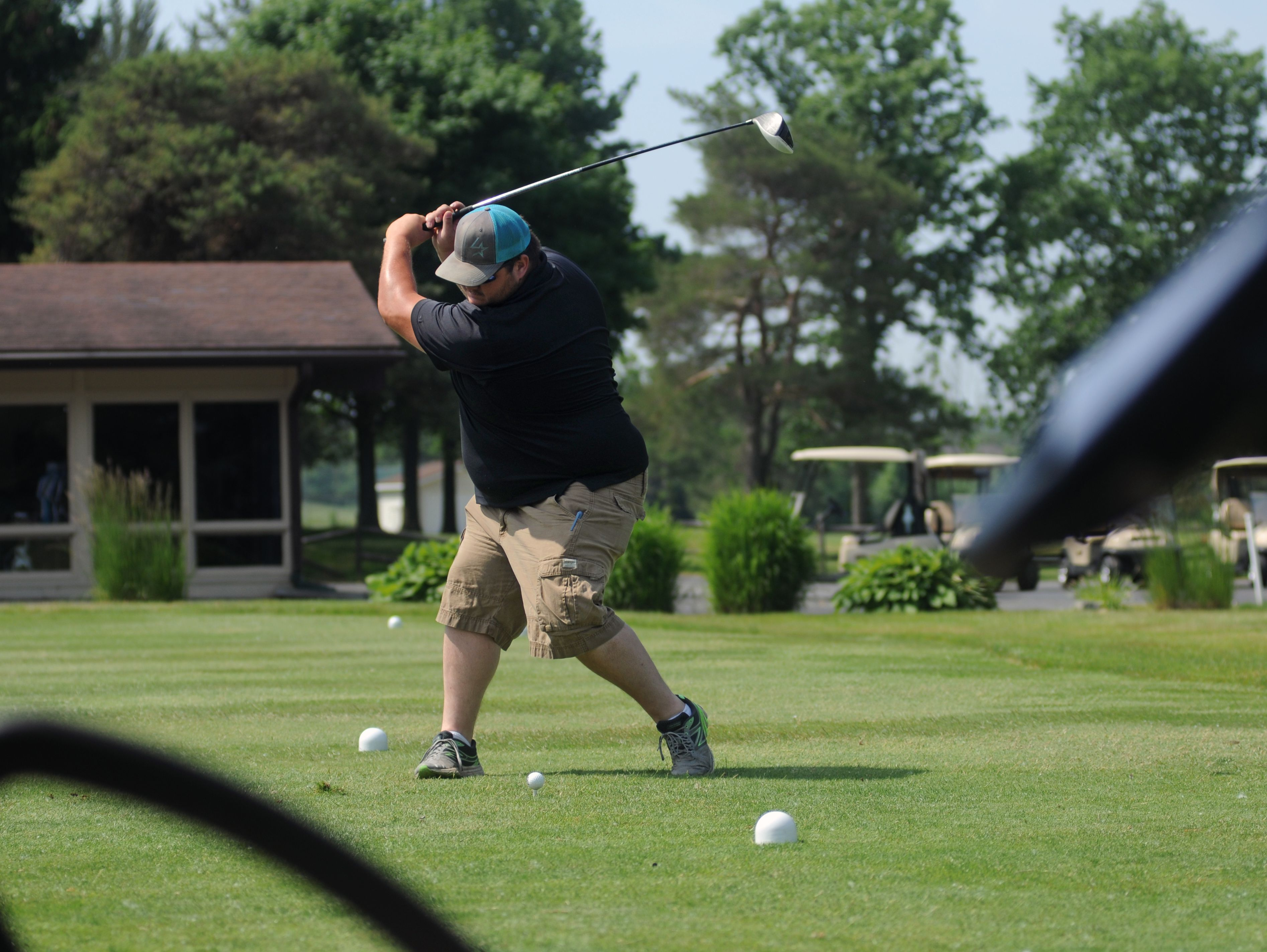 Jeff Lelito tees off Monday, June 20, during the Lelito Legacy Golf Outing at St. Clair Golf Cub.