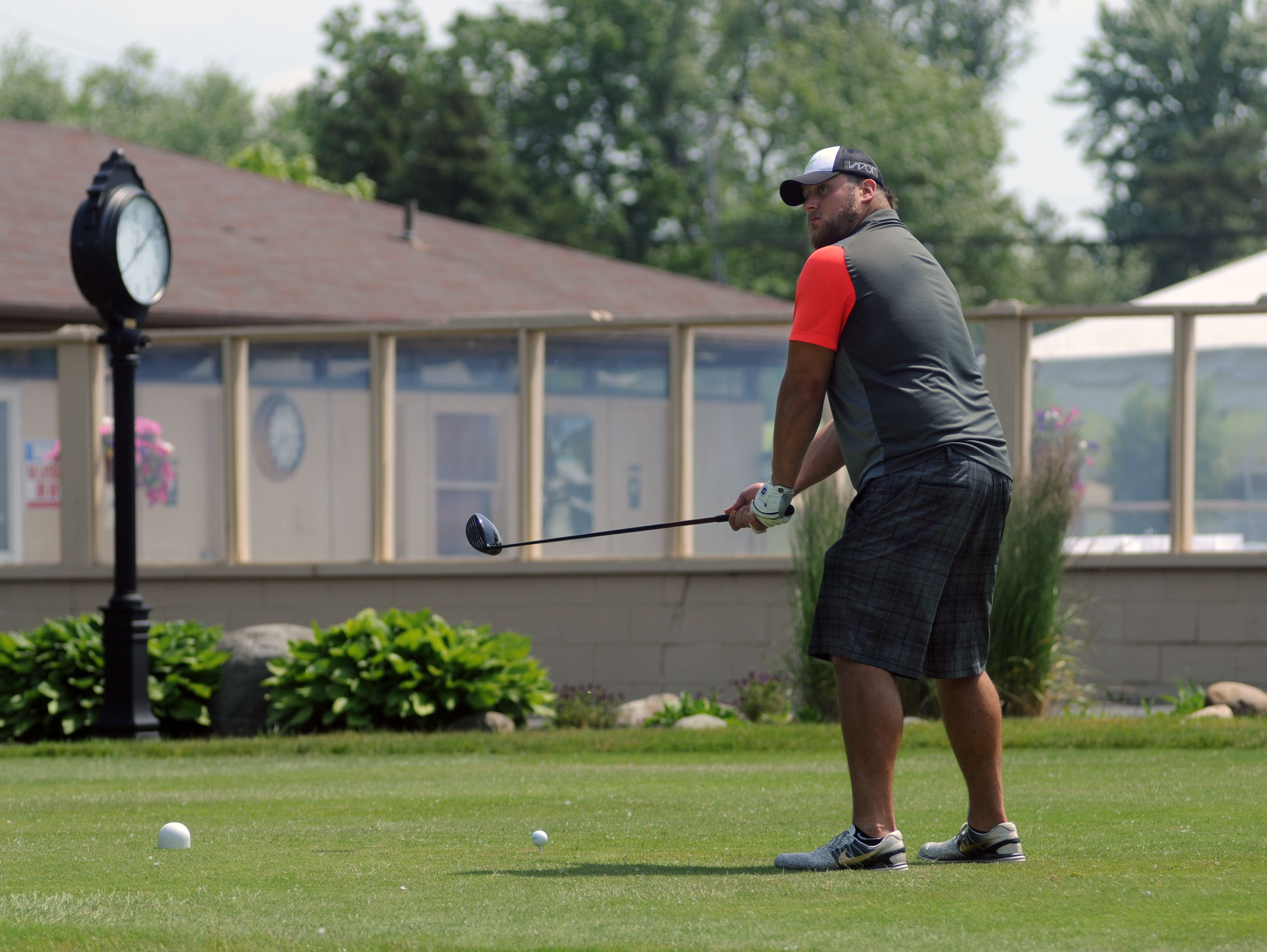 Tim Lelito readies his drive Monday, June 20, during the Lelito Legacy Golf Outing at St. Clair Golf Cub.