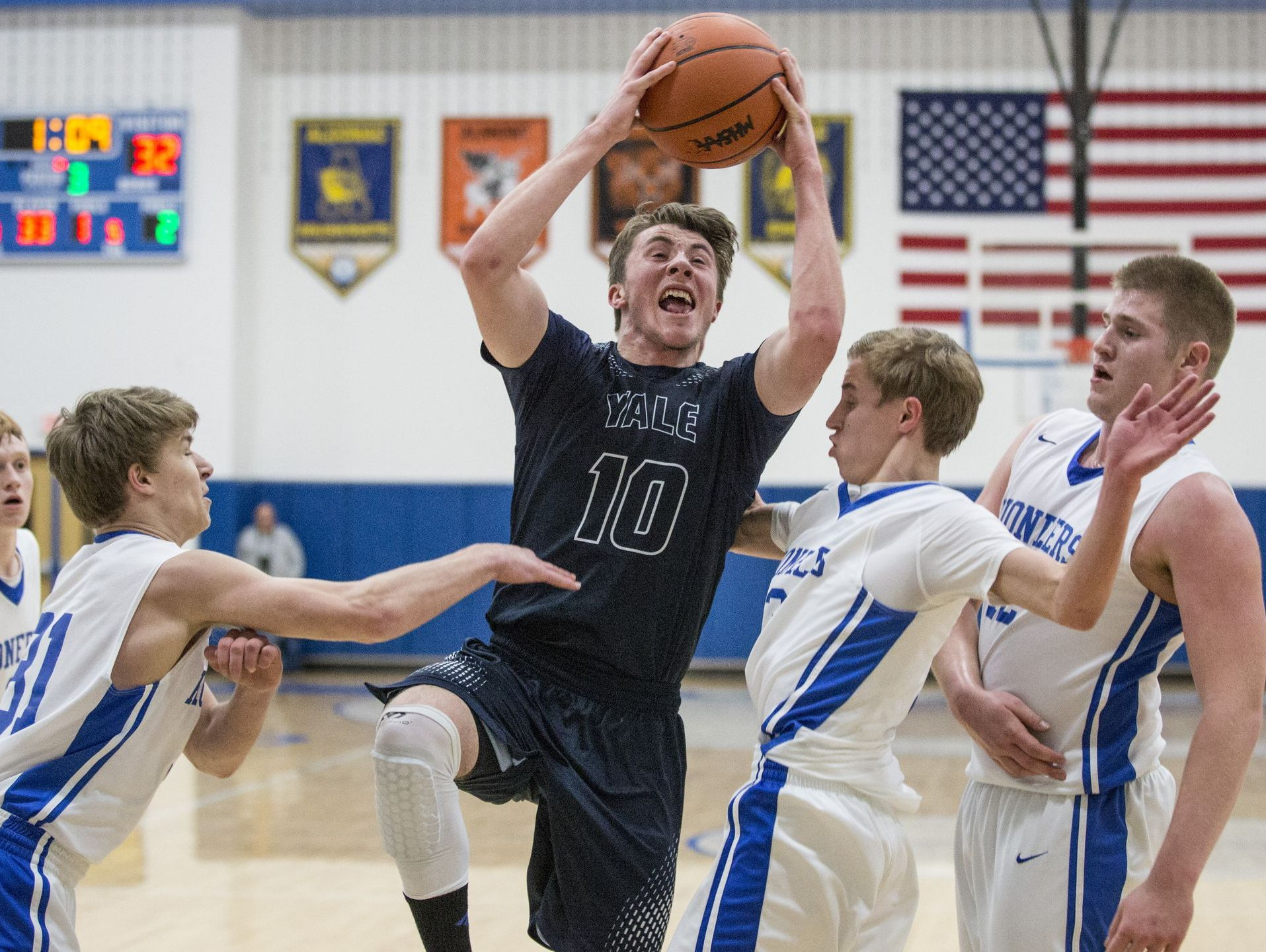 Yale senior Cody Kelgey goes for a shot during a district final basketball game Friday, March 11, 2016 at Cros-Lex High School.