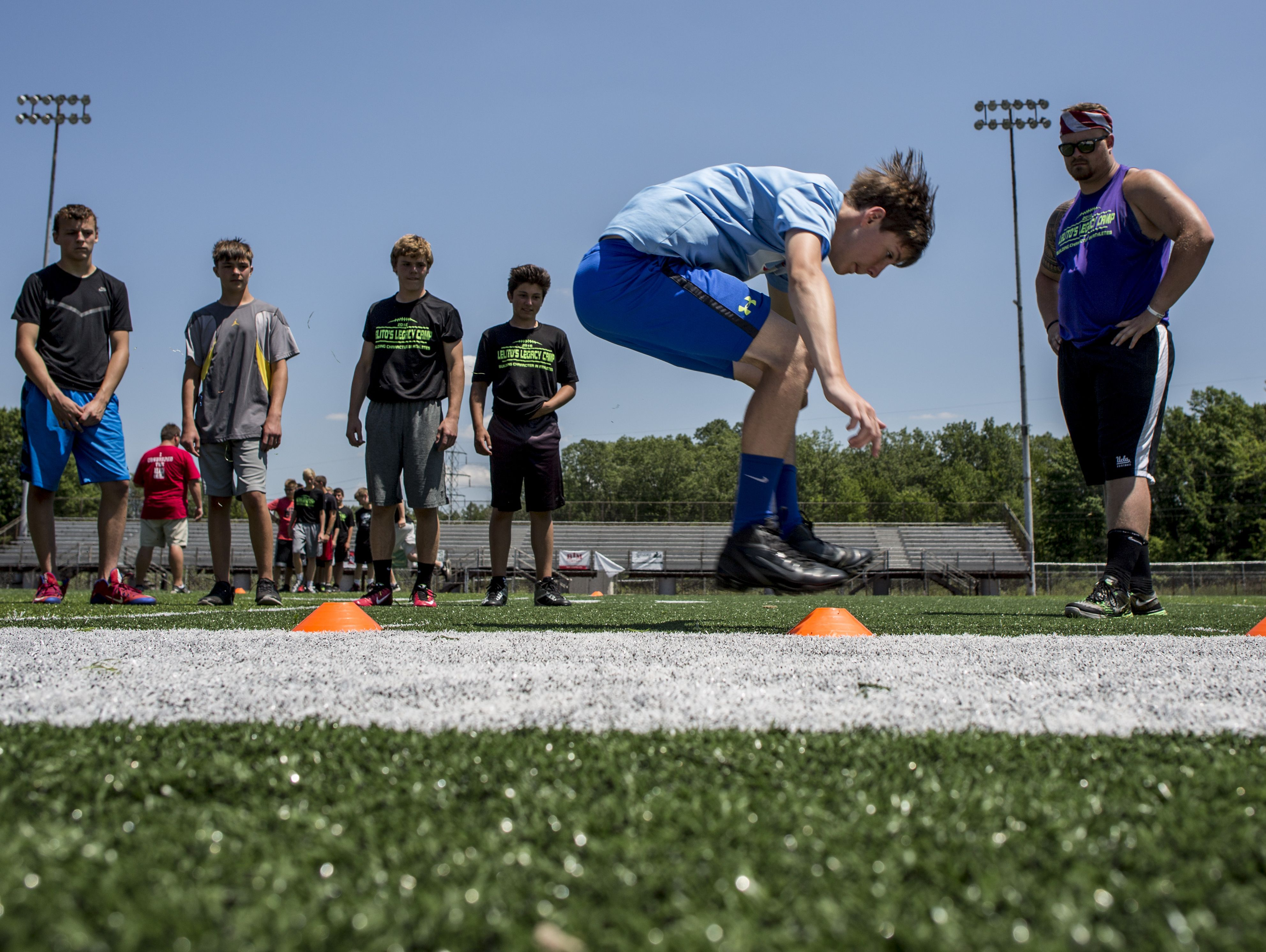 Will Nesbitt, 14, of St. Clair, does a standing long jump as others watch during Lelito's Legacy Camp Friday, June 24, 2016 at the East China Stadium.