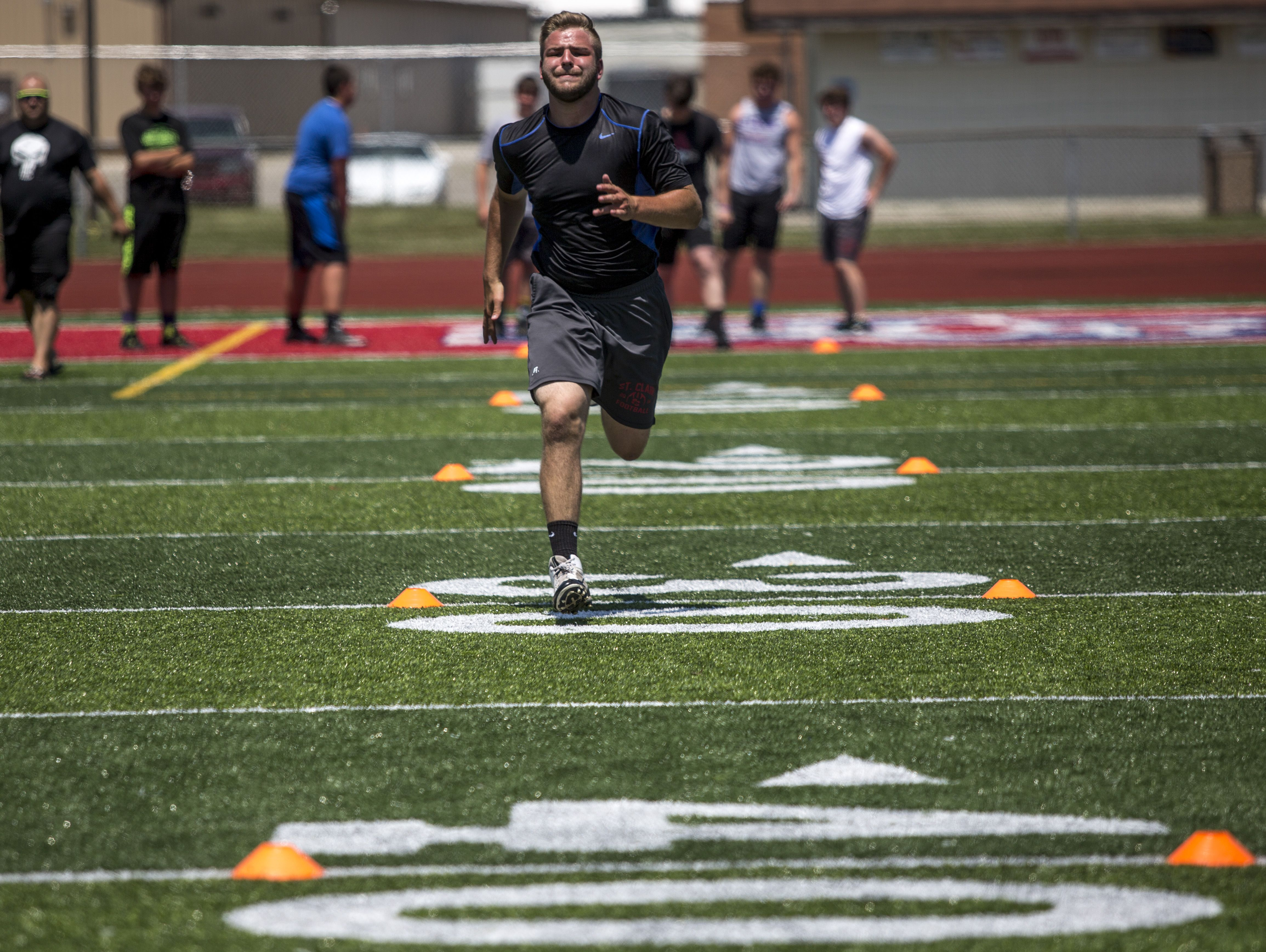 Noah Gabriel, 15, of St. Clair, does a 40-yard sprint during Lelito's Legacy Camp Friday, June 24, 2016 at the East China Stadium.
