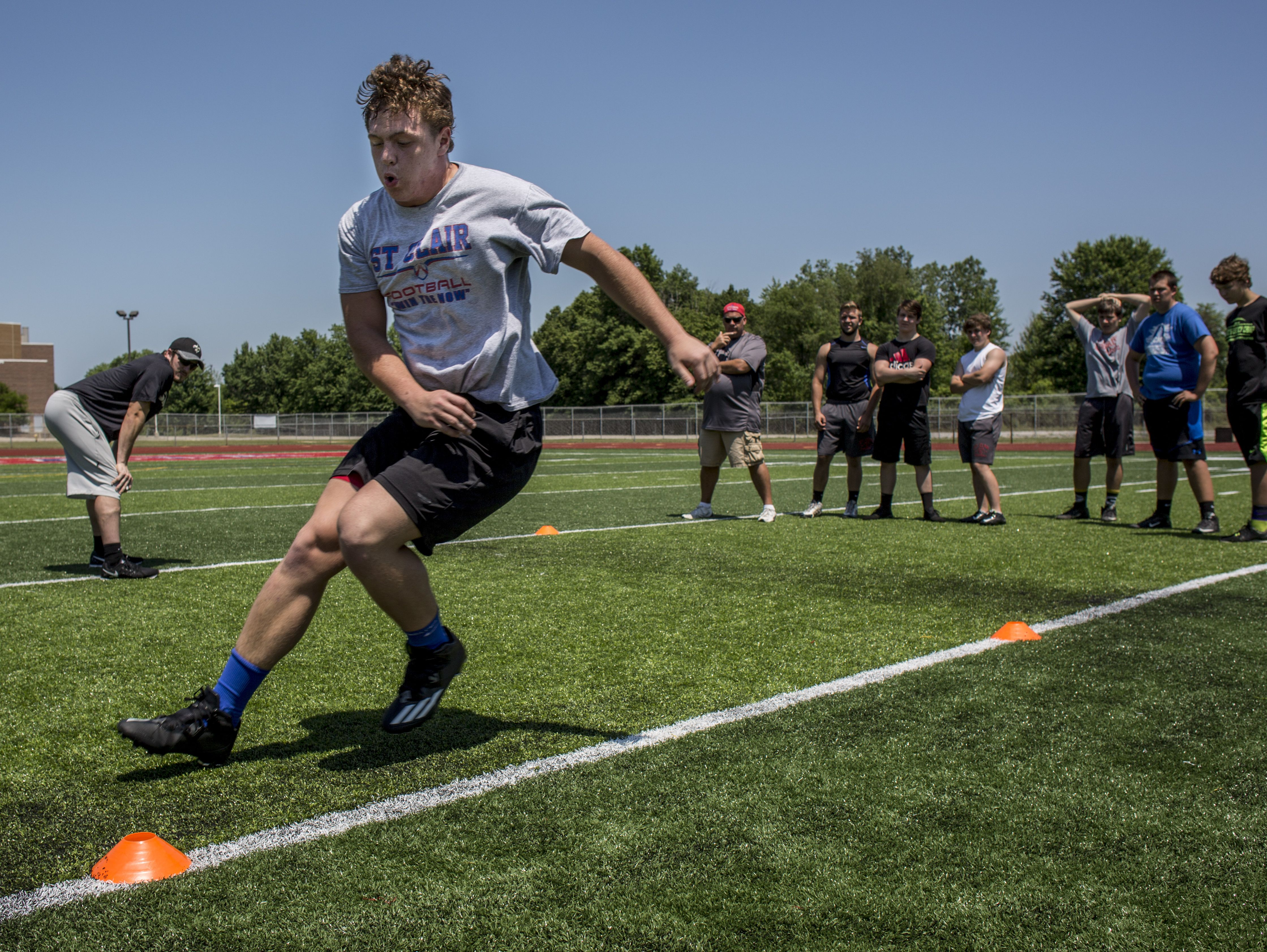 AJ Aguilo, 17, of St. Clair, works on agility with an L-drill during Lelito's Legacy Camp Friday, June 24, 2016 at the East China Stadium.