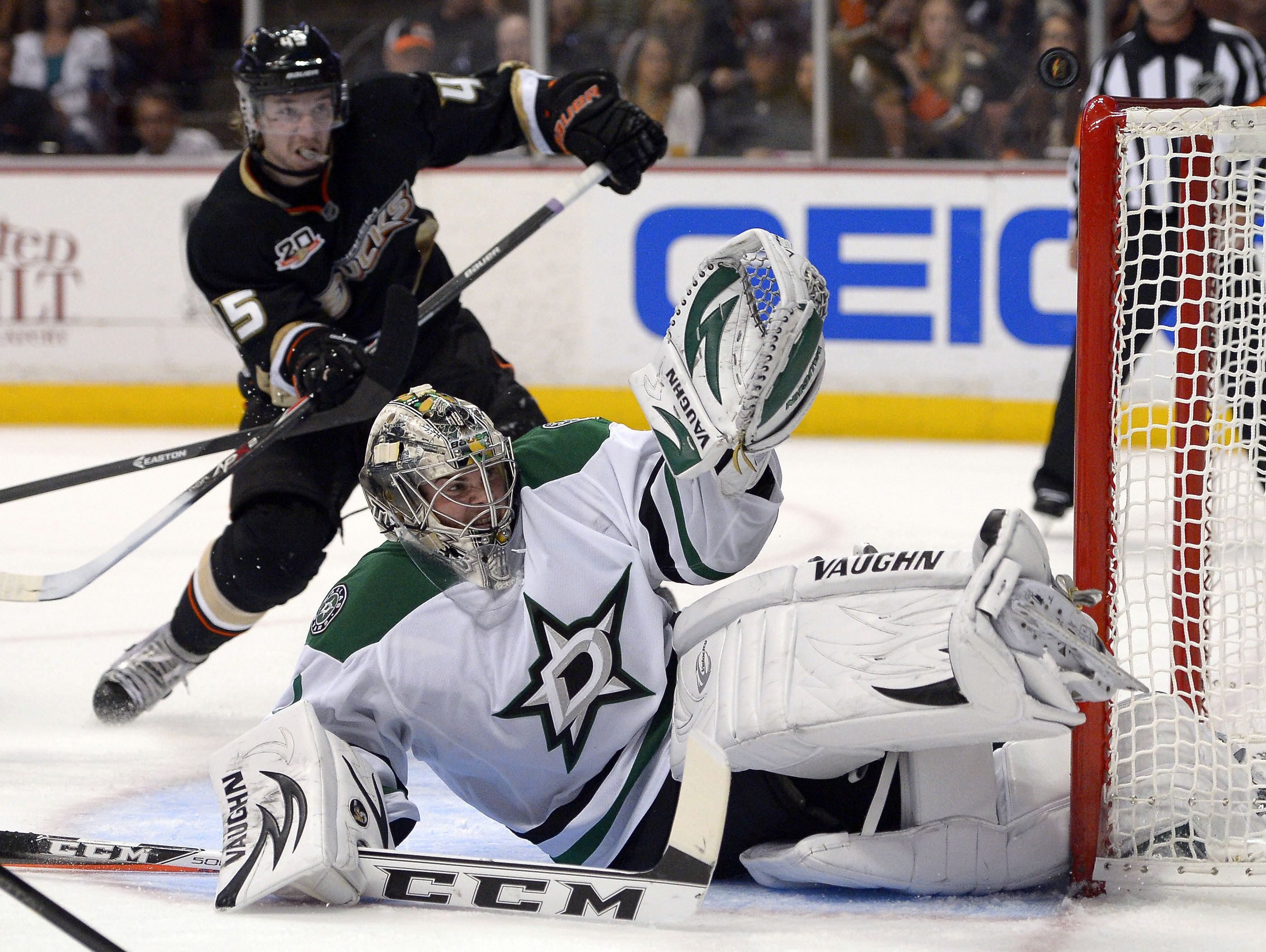 Dallas Stars goalie Jack Campbell, a Port Huron native, deflects a shot in his NHL debut Sunday against the Anaheim Ducks. The Stars lost, 6-3, but Campbell finished with 41 saves. Mark j. terrill/aP Dallas Stars goalie Jack Campbell, below, deflects a shot as Anaheim Ducks defenseman Sami Vatanen looks on during the second period of their NHL hockey game, Sunday, Oct. 20, 2013, in Anaheim, Calif.