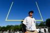 Michigan coach Jim Harbaugh walks on the field during the Next Level Football Camp at Paramus Catholic High School, Wednesday, June 8, 2016, in Paramus, N.J. (AP Photo/Julio Cortez) ORG XMIT: NJJC112