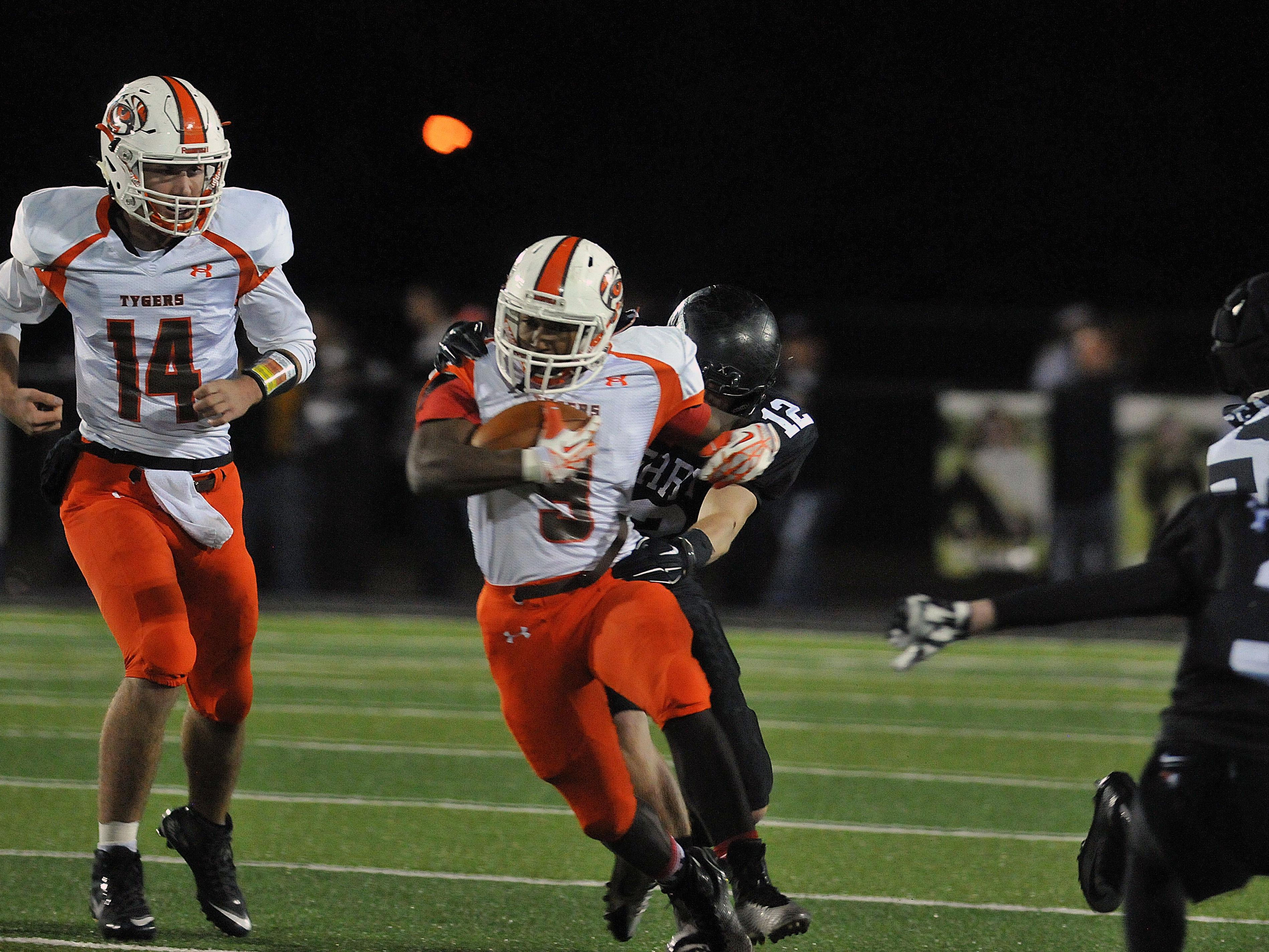 Mansfield Senior running back Brian Benson runs for yards against Massillon Perry in a high school football playoff game this season. Benson was named second-team All-Ohio as a running back in Division II.