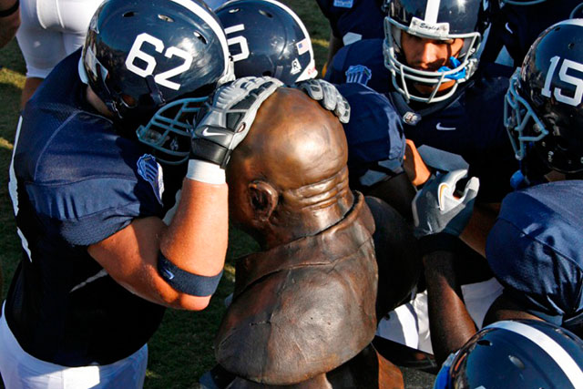 Georgia Southern football players head butt the statue of former coach Erk Russell before games. (Photo: Georgia Southern Football).