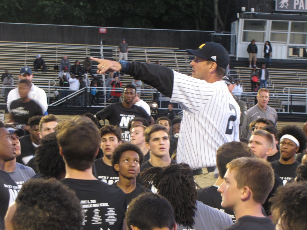 Michigan coach Jim Harbaugh, sporting a Derek Jeter Yankees jersey, makes a point to players at his Next Level Camp Wednesday at Paramus Catholic in Paramus, N.J. (Photo: Jim Halley, USA TODAY Sports).