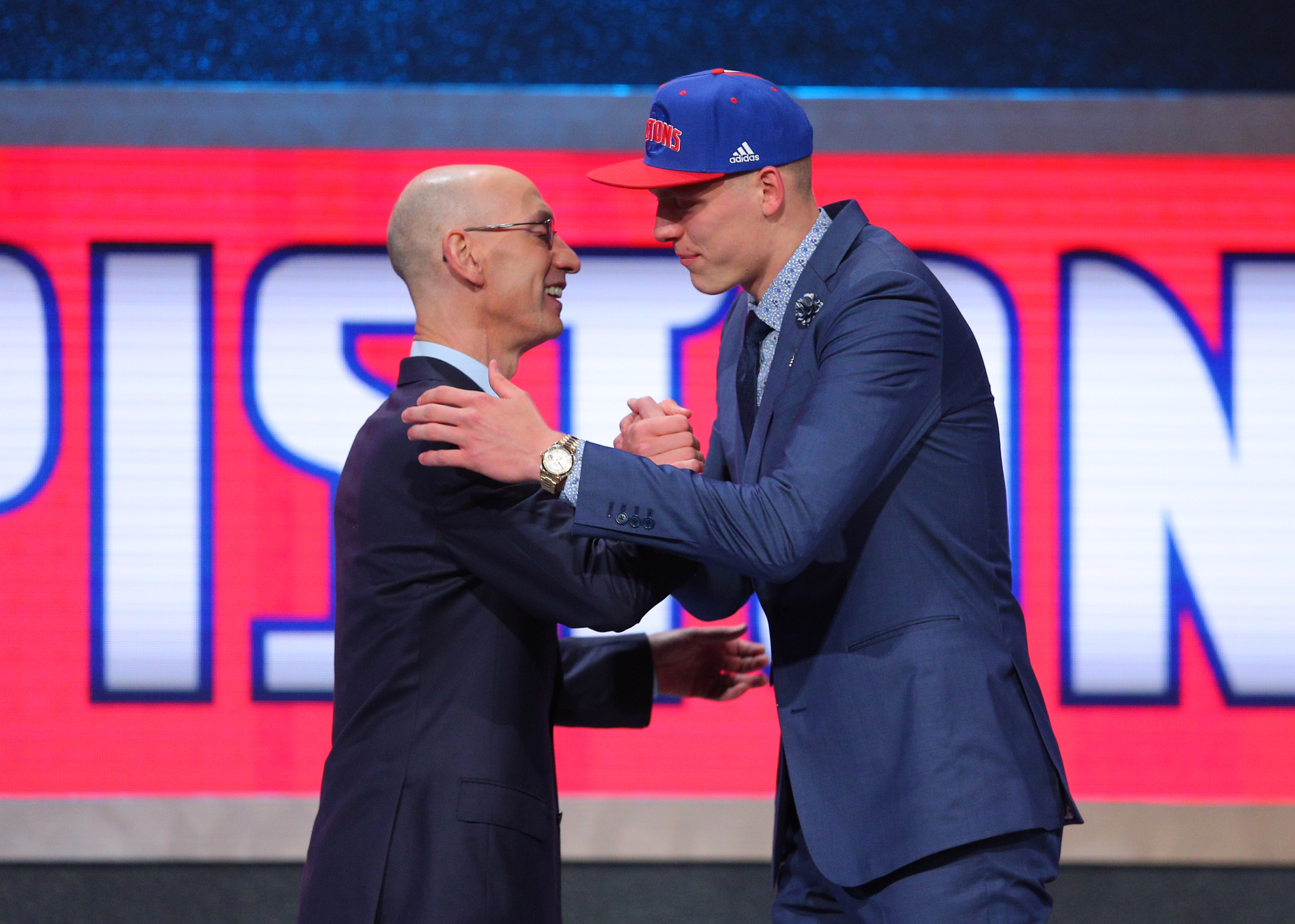 Jun 23, 2016; New York, NY, USA; Henry Ellenson (Marquette) greets NBA commissioner Adam Silver after being selected as the number eighteen overall pick to the Detroit Pistons in the first round of the 2016 NBA Draft at Barclays Center. Mandatory Credit: Brad Penner-USA TODAY Sports ORG XMIT: USATSI-269318 ORIG FILE ID: 20160623_jel_ae5_163.jpg