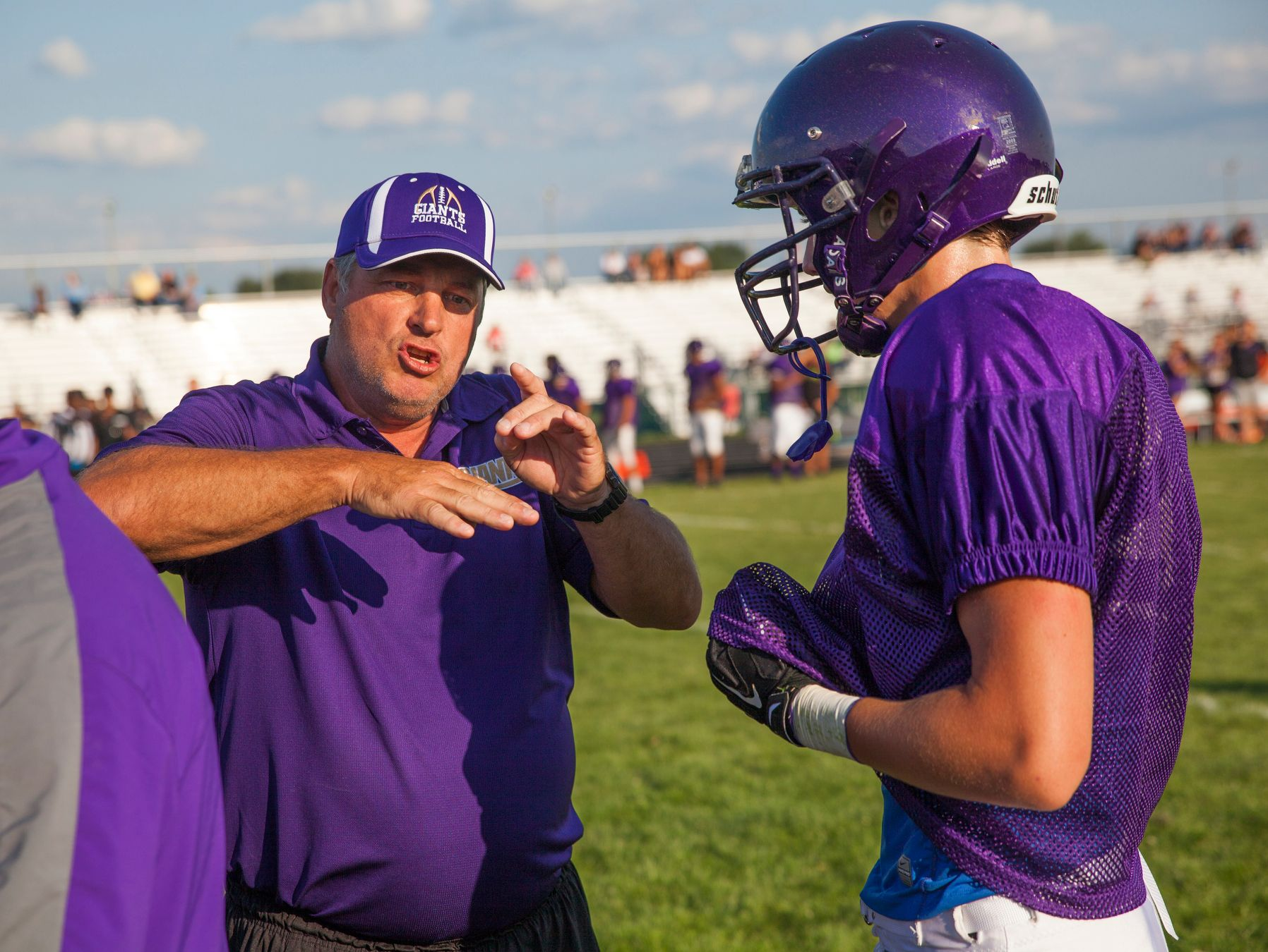 "Waynesboro football coach Derek McDaniel, left, said he'll have fewer ""two-a-day"" practices with his players because of the earlier start to the school year."