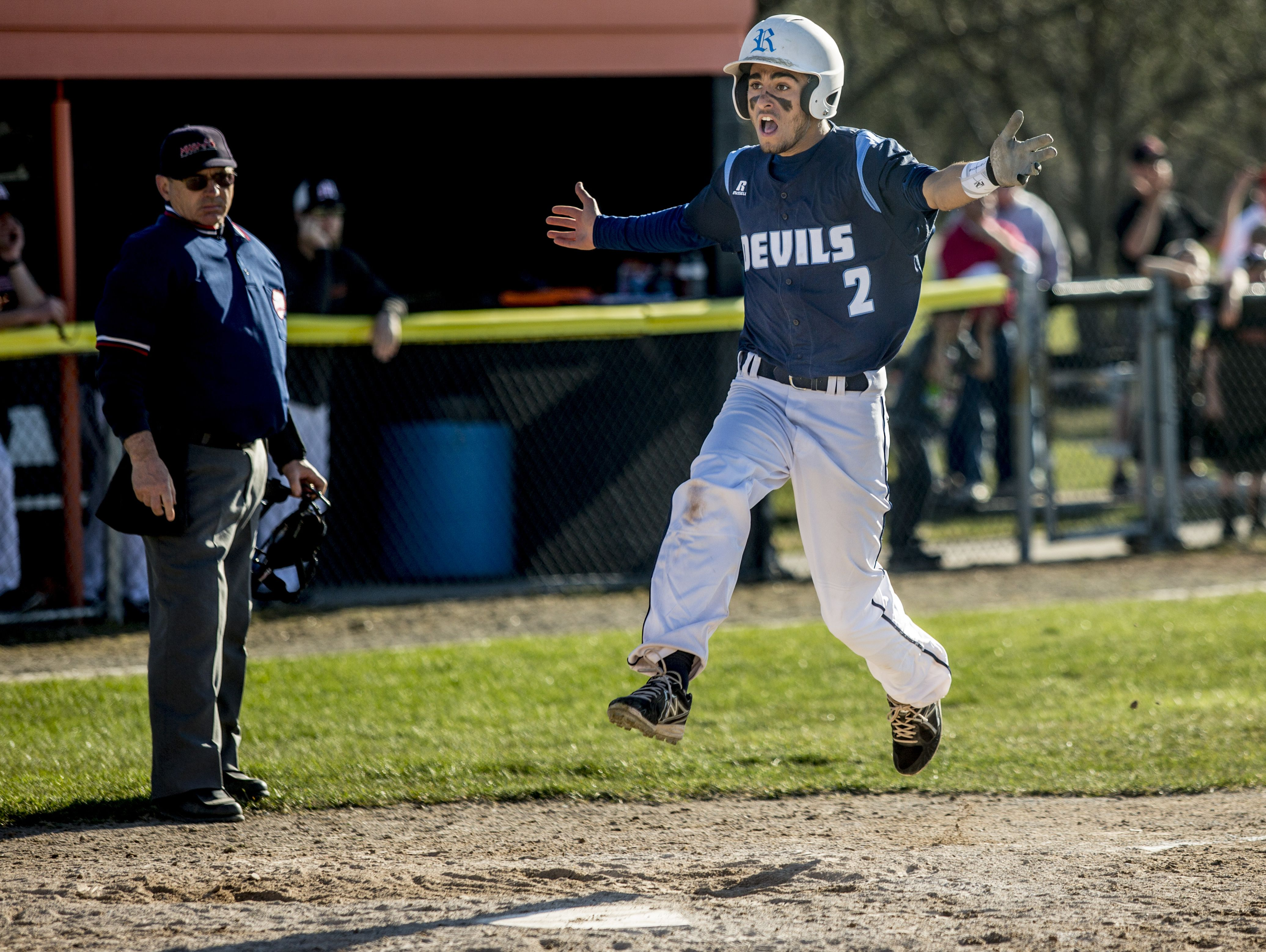 Richmond's Stefan Fenwick celebrates as he runs home to score during a baseball game Friday, April 15, 2016 at Marine City High School.