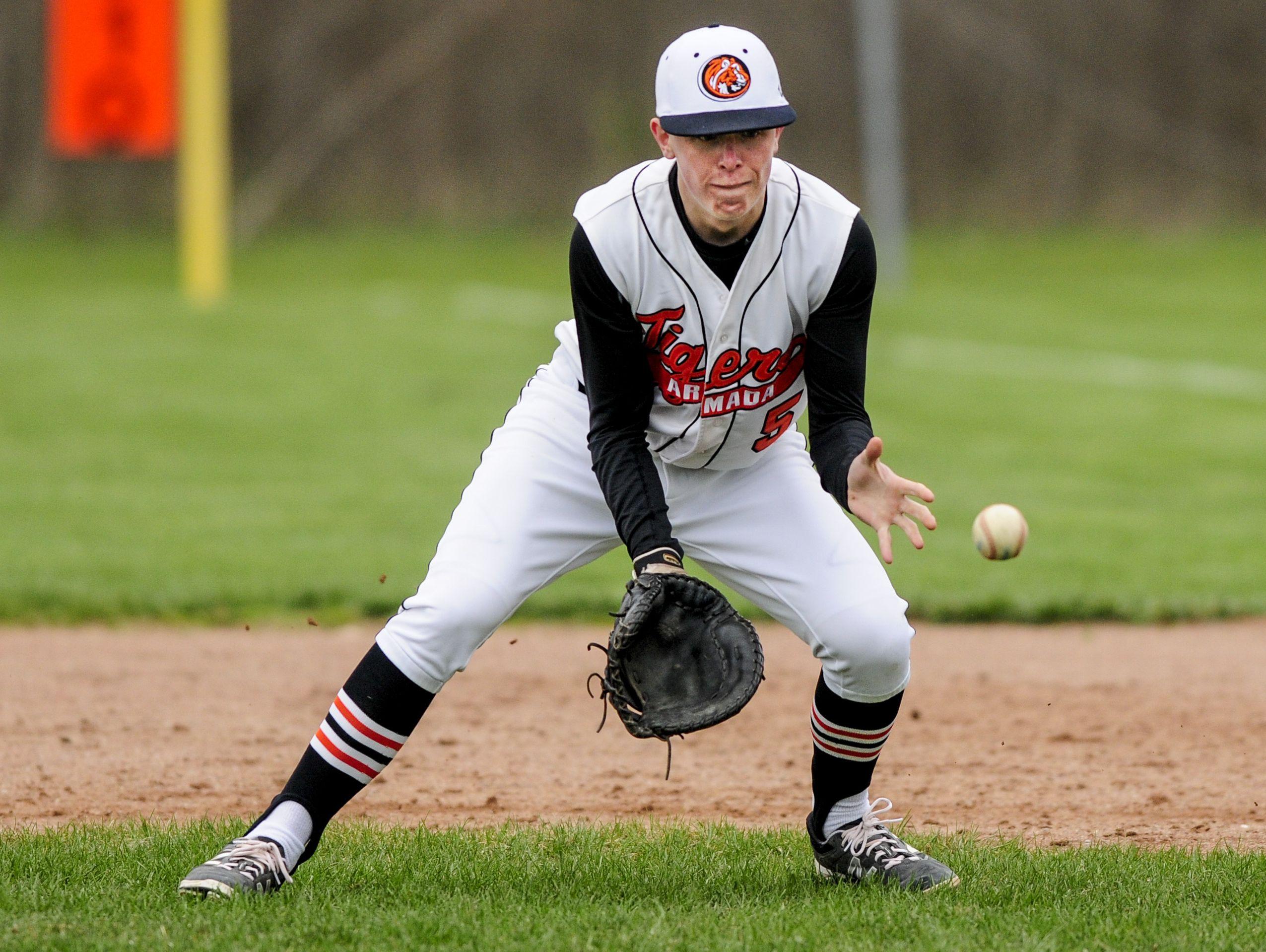 Armada's Mitch Ruczynski fields the ball during a baseball game Thursday, April 28, 2016 at Armada High School.
