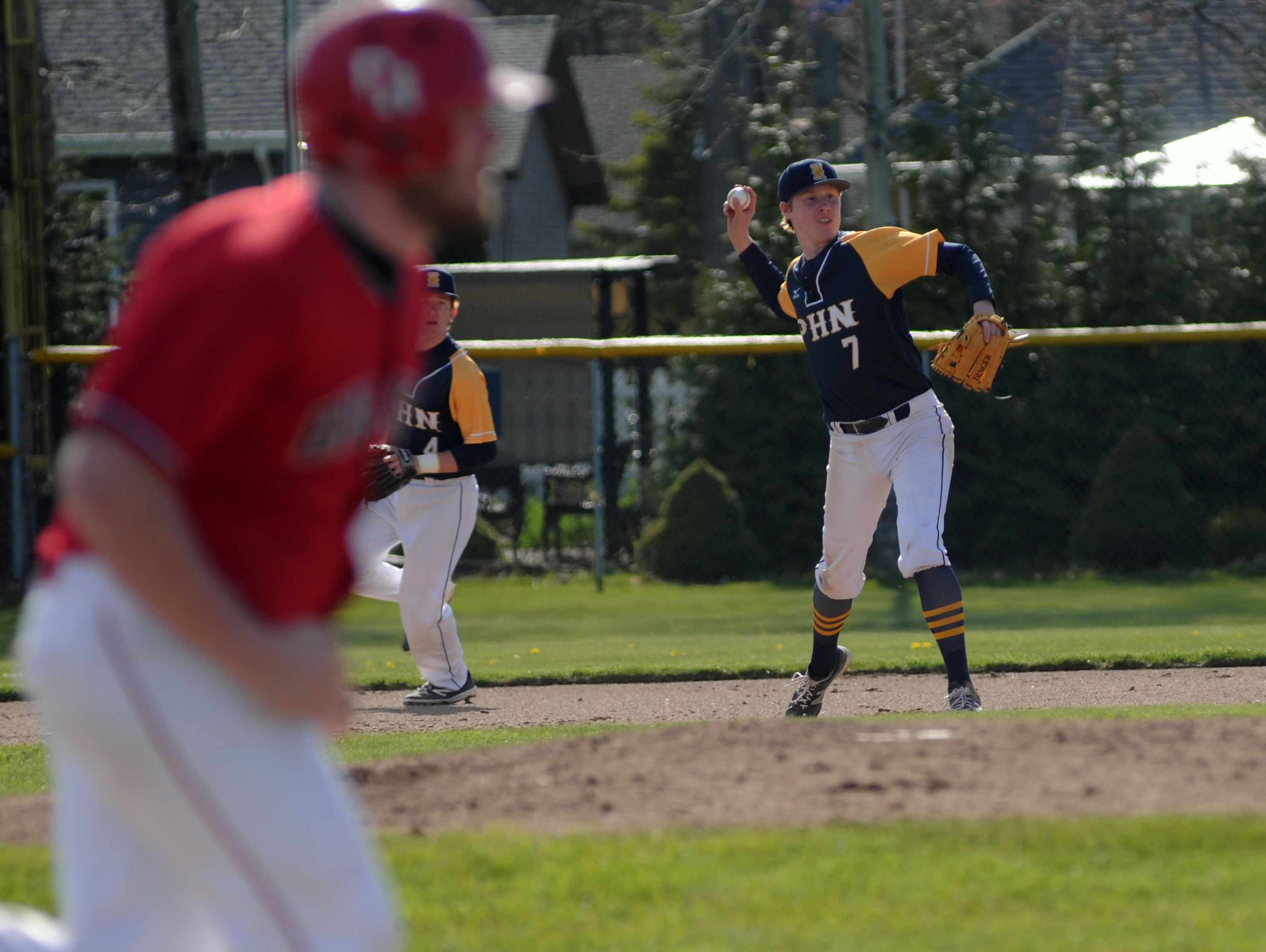 Huskies' Nick Trimble throws to first for the out Monday, May 2, during a varsity baseball match against Port Huron.