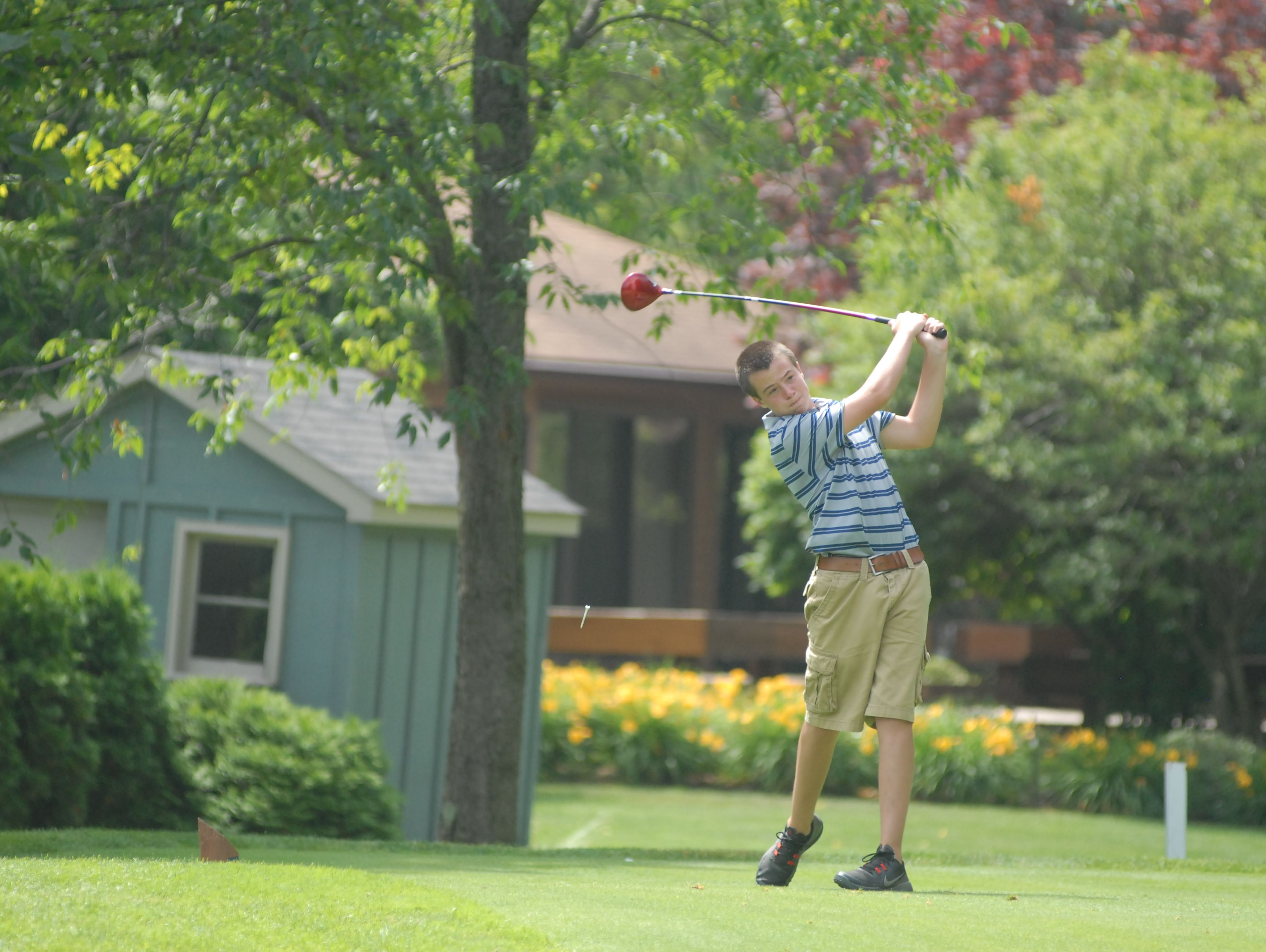 Yale's Justin Furhman drives the ball down the fairway at the Blue Water Junior Golf Tournament event at Port Huron Golf Club on July 8, 2016.