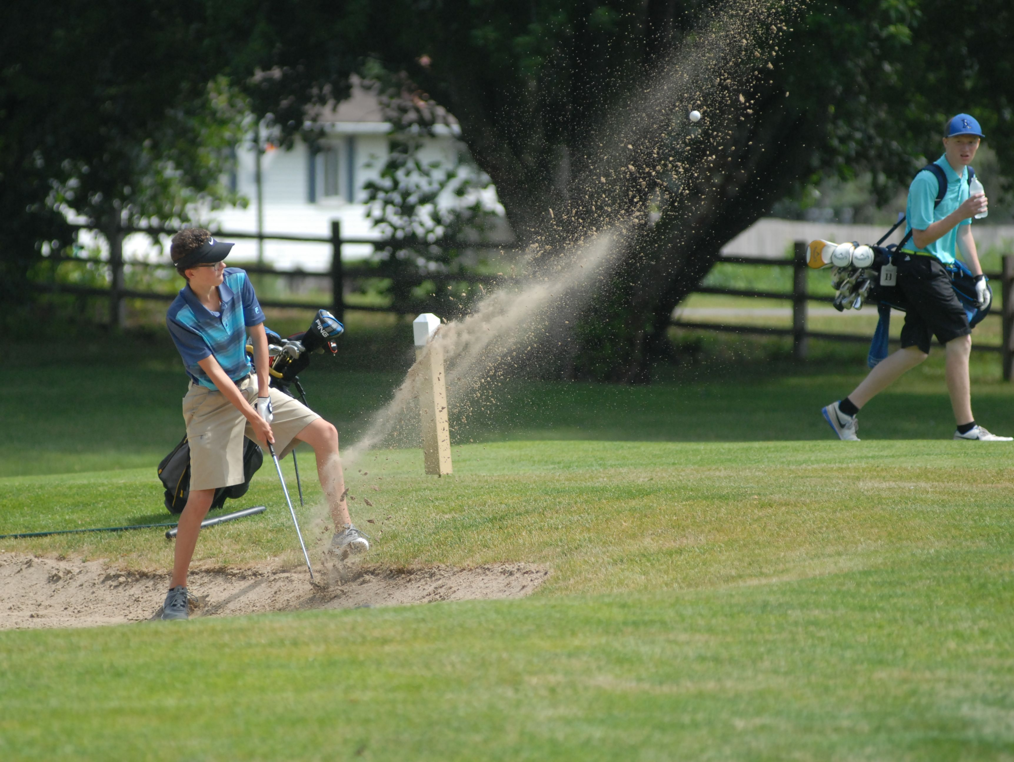 Chesterfield's Evan DeBruyne hits the ball out of sand at the Blue Water Junior Golf Tournament event at Port Huron Golf Club on July 8, 2016.