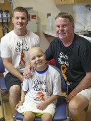From left, Daniel Gavaghan, Brody Stephens and Bob Gavaghan smile for a photo at Riley Hospital for Children, Wednesday, July 13, 2016. The Gavaghan family hosts a charity backyard basketball game annually and this year's proceeds will go toward a trip of Brody's choice. (Photo: Jenna Watson/IndyStar)