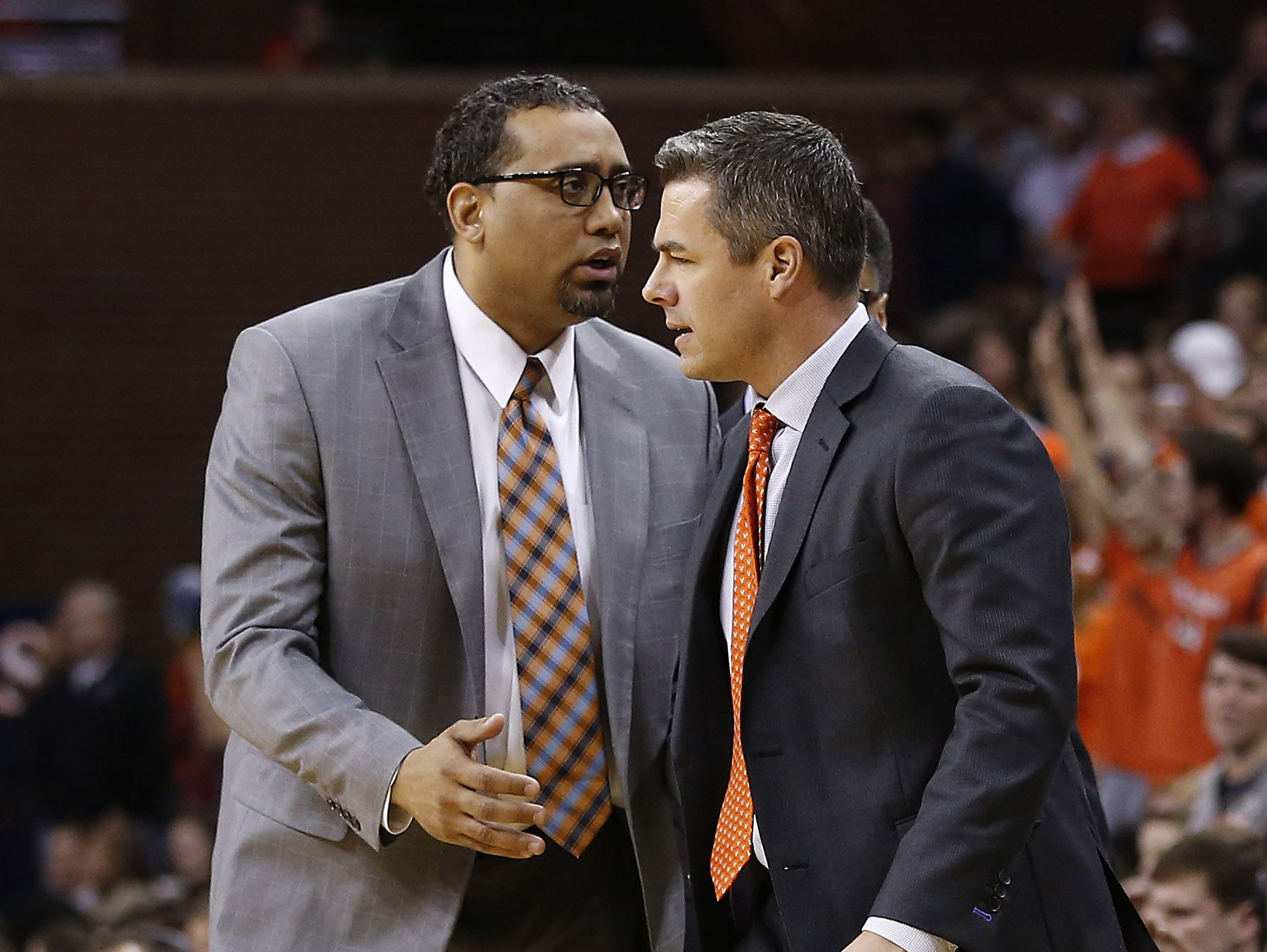Feb 28, 2015; Charlottesville, VA, USA; Virginia Cavaliers assistant coach Jason Williford, left, with head coach Tony bennett, has been on the moved for most of the summer, evaluating talent at AAU basketball events.