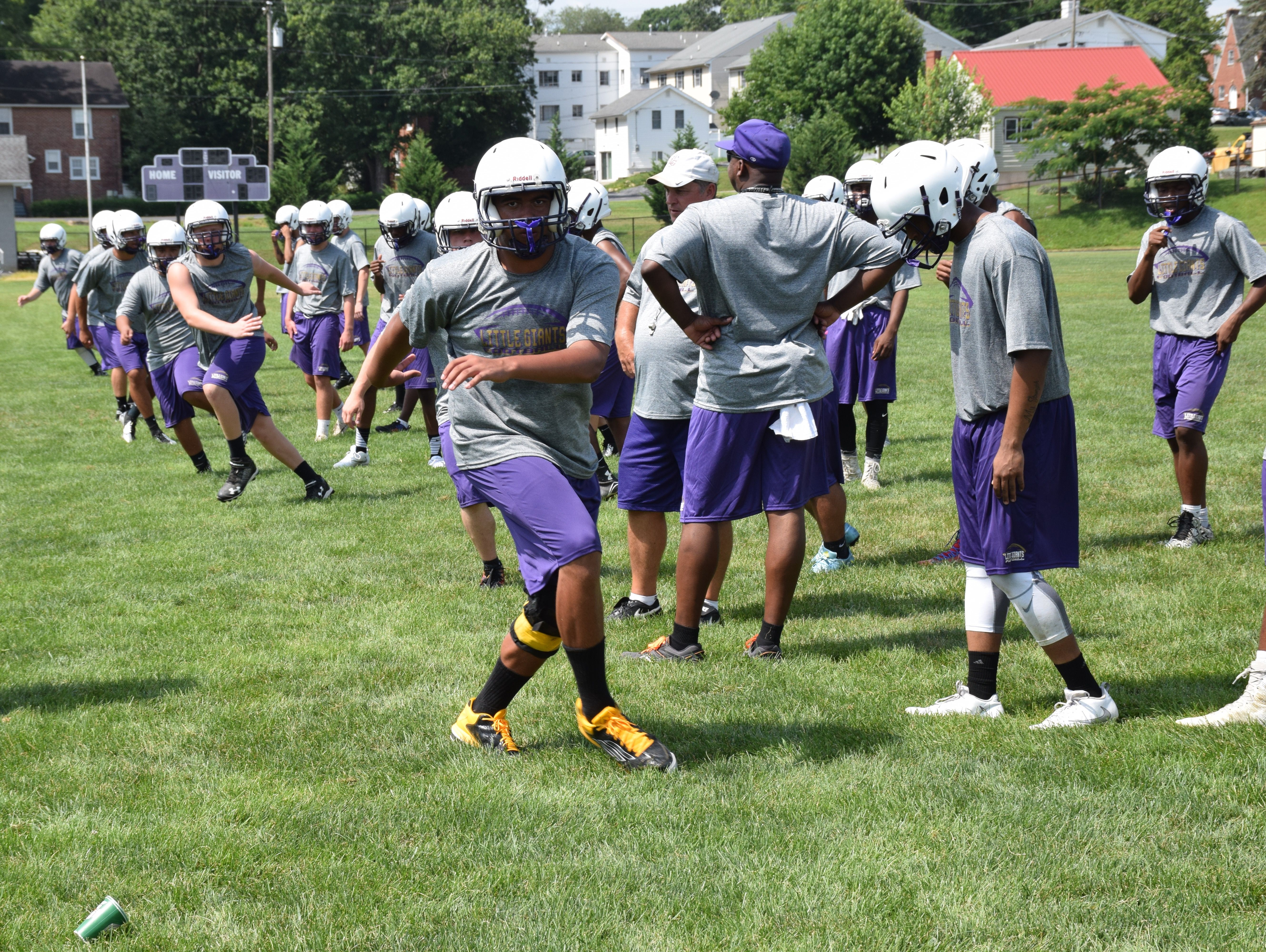 Waynesboro High School football players go through an agility drill during the first day of practice on Thursday, July 28, 2016, at Waynesboro High School