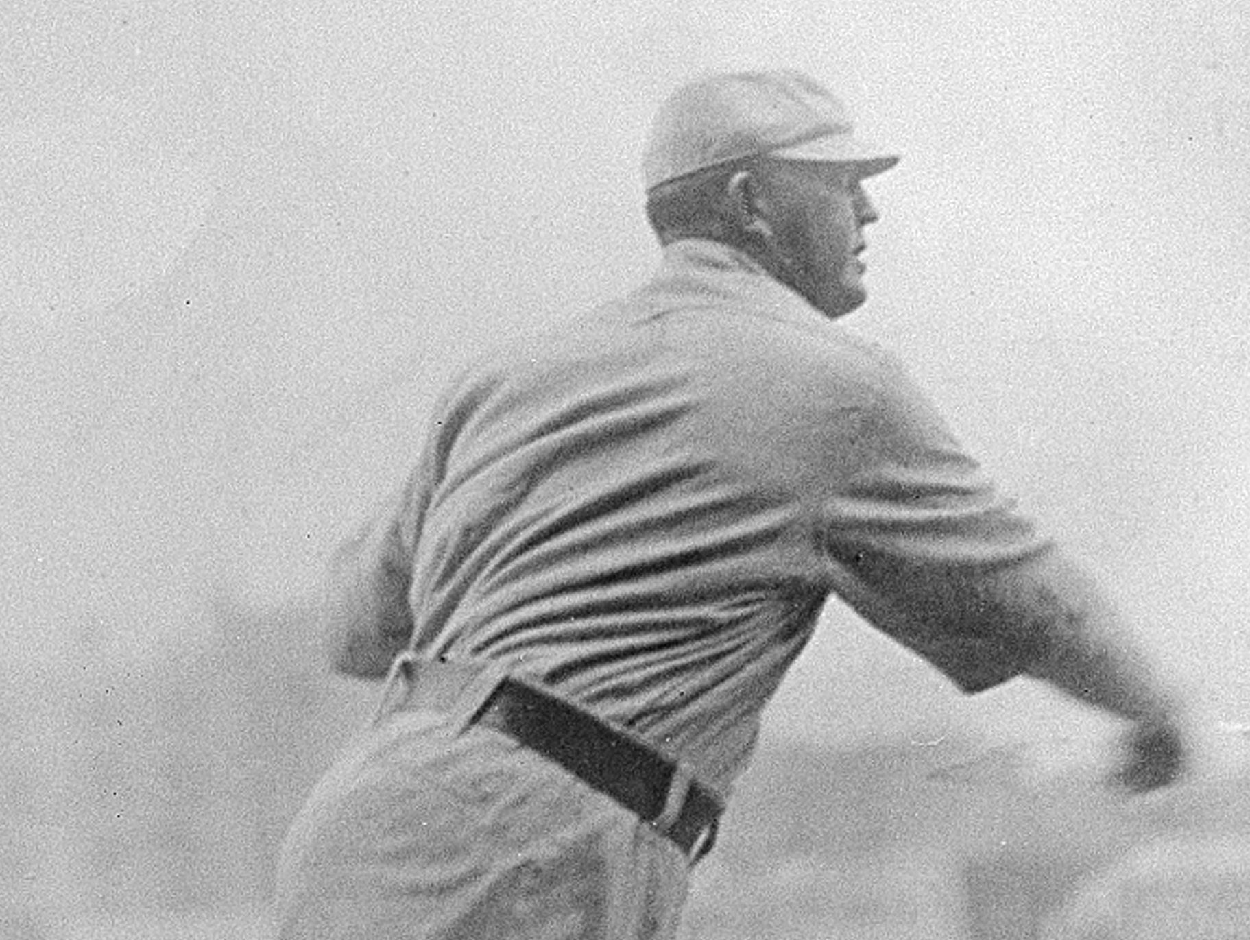 Cy Young, pitcher for Cleveland Indians, throws a pitch in this undated photo in Cleveland, Ohio. The right-hand pitcher has set various records, among them are games started, 816 or 818; completed starts, 750 or 751; and innings pitched, 7,356 or 7,377.