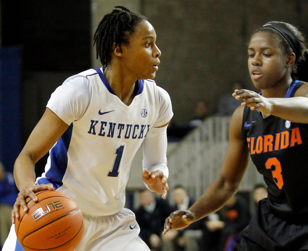 Kentucky's A'dia Mathies, left, looks for an opening against Florida's January Miller during the second half of an NCAA women's college basketball game at Rupp Arena in Lexington, Ky., Thursday, Jan. 3, 2013. Kentucky defeated Florida 76-69. (AP Photo/James Crisp)