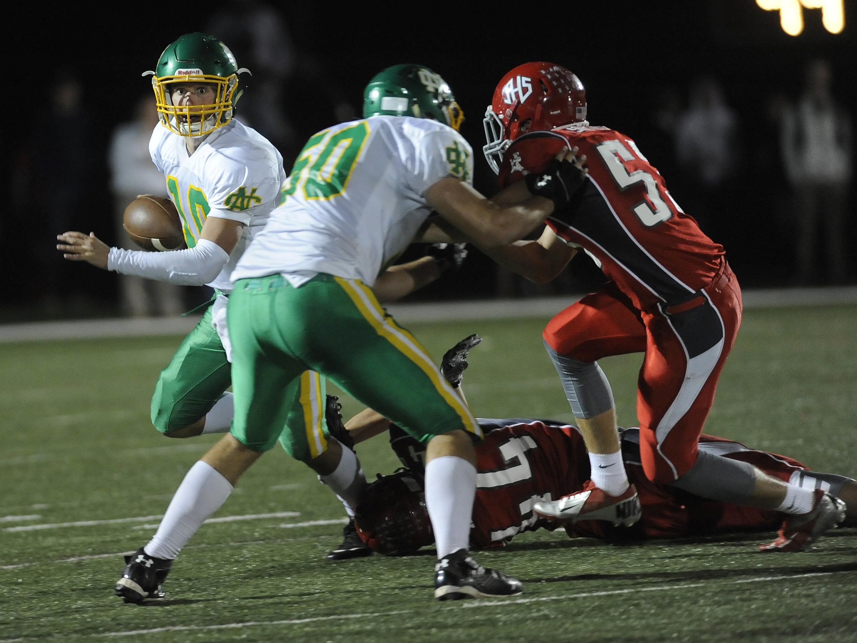 Newark Catholic's Nick Cavinee, front, blocks a Johnstown defender during a game this season.