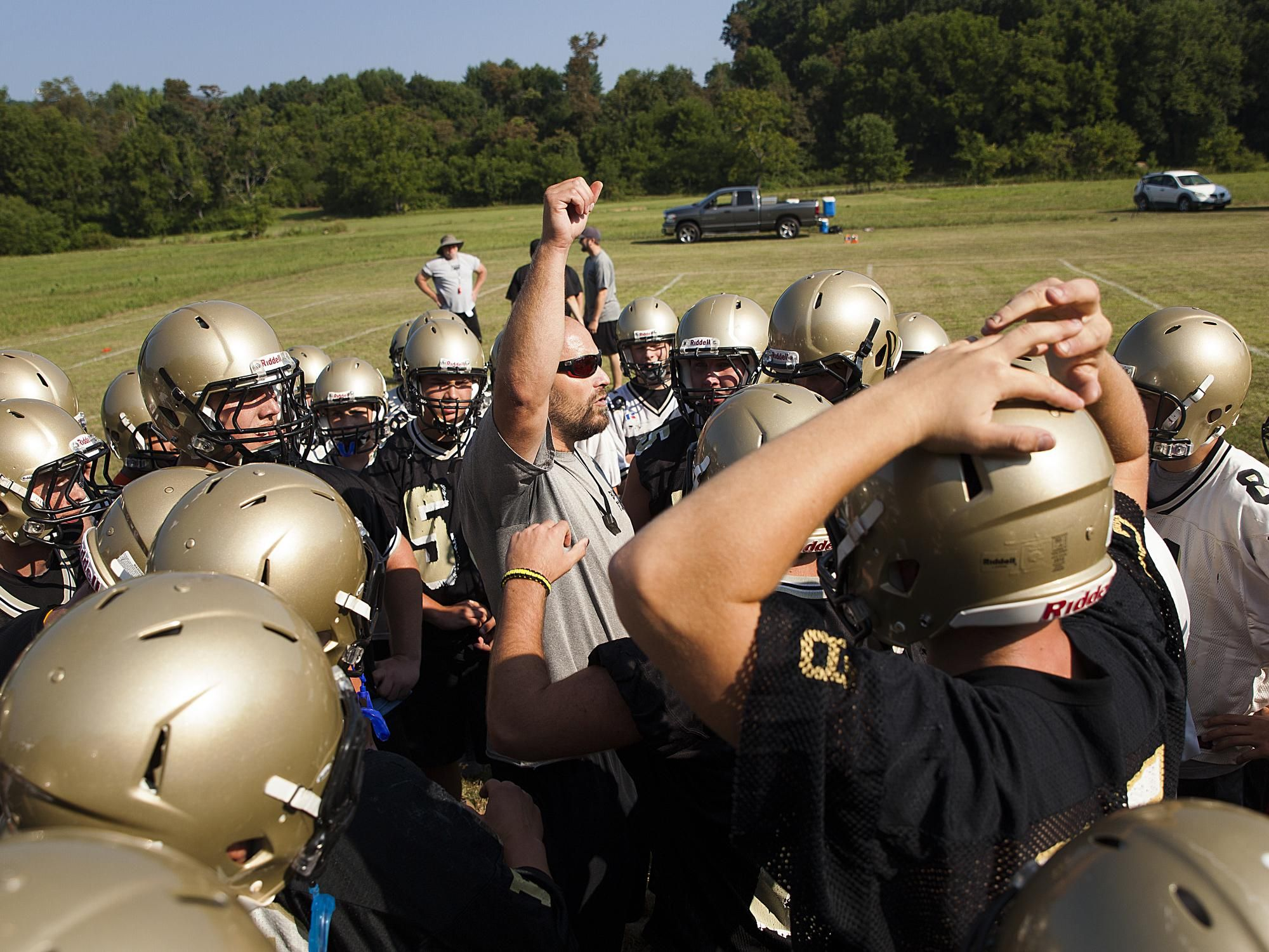 Buffalo Gap football coach Andy Cline, center, talks to his players during a practice last season.
