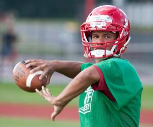 Jeffersonville quarterback Cameron Northern prepares to throw during practice. 11 August 2016