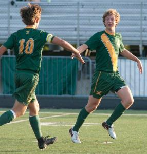 St. Xavier midfielder Theodore Ennenbach, left, congratulates teammate Lucas Mudd for Mudd's score, the first of the game as St. Xavier plays South Oldham. 24 August 2016