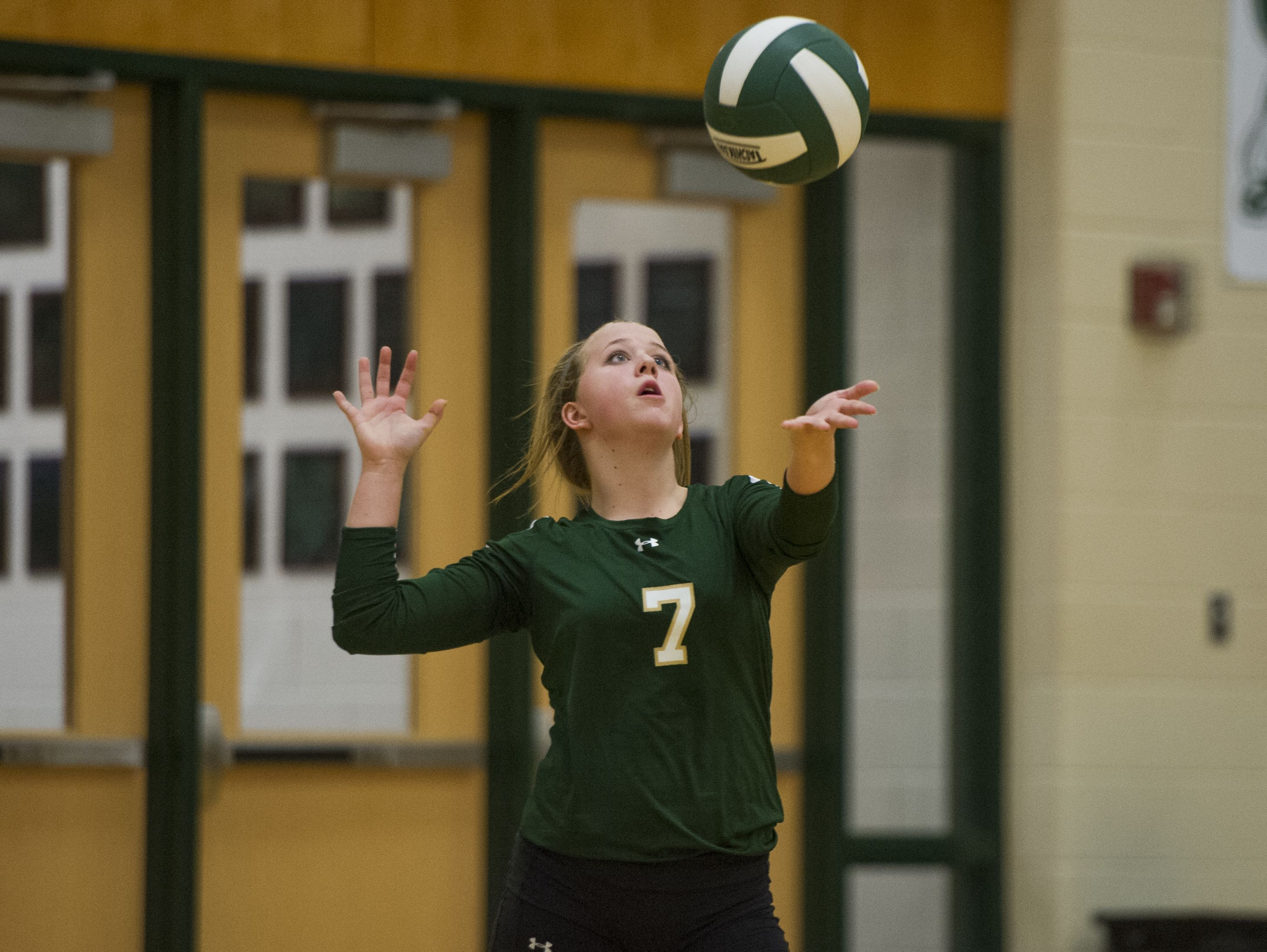Wilson Memorial's Peyton Sykes serves against East Rockingham during their Conference 36 volleyball game on Monday, Nov. 2, 2015.