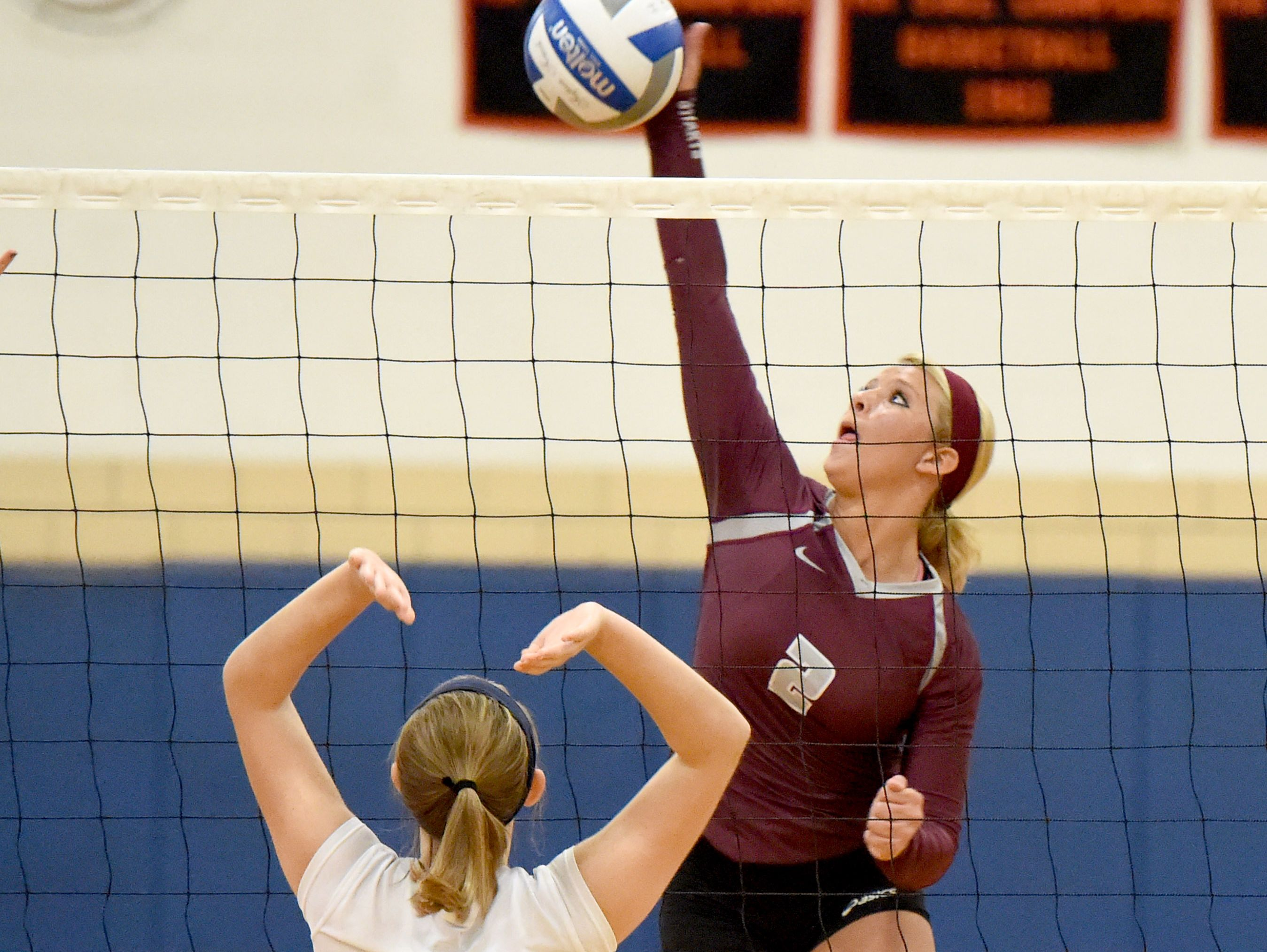 Stuarts Draft's Danielle Brenneman hits the ball back across the net during the Conference 36 volleyball championship played in Staunton on Thursday, Nov. 5, 2015.