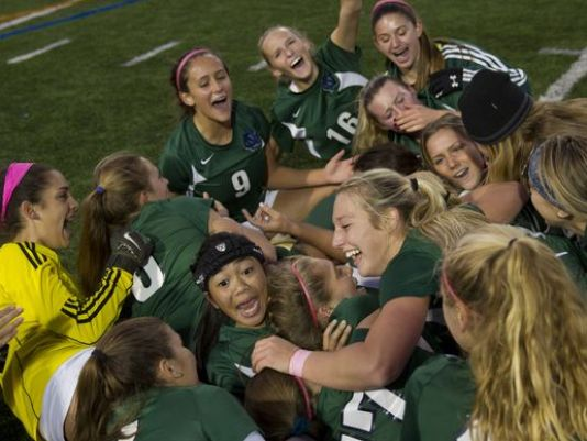 The Colts Neck girls soccer team celebrates its state title (Photo: Peter Ackerman, Gannett New Jersey)