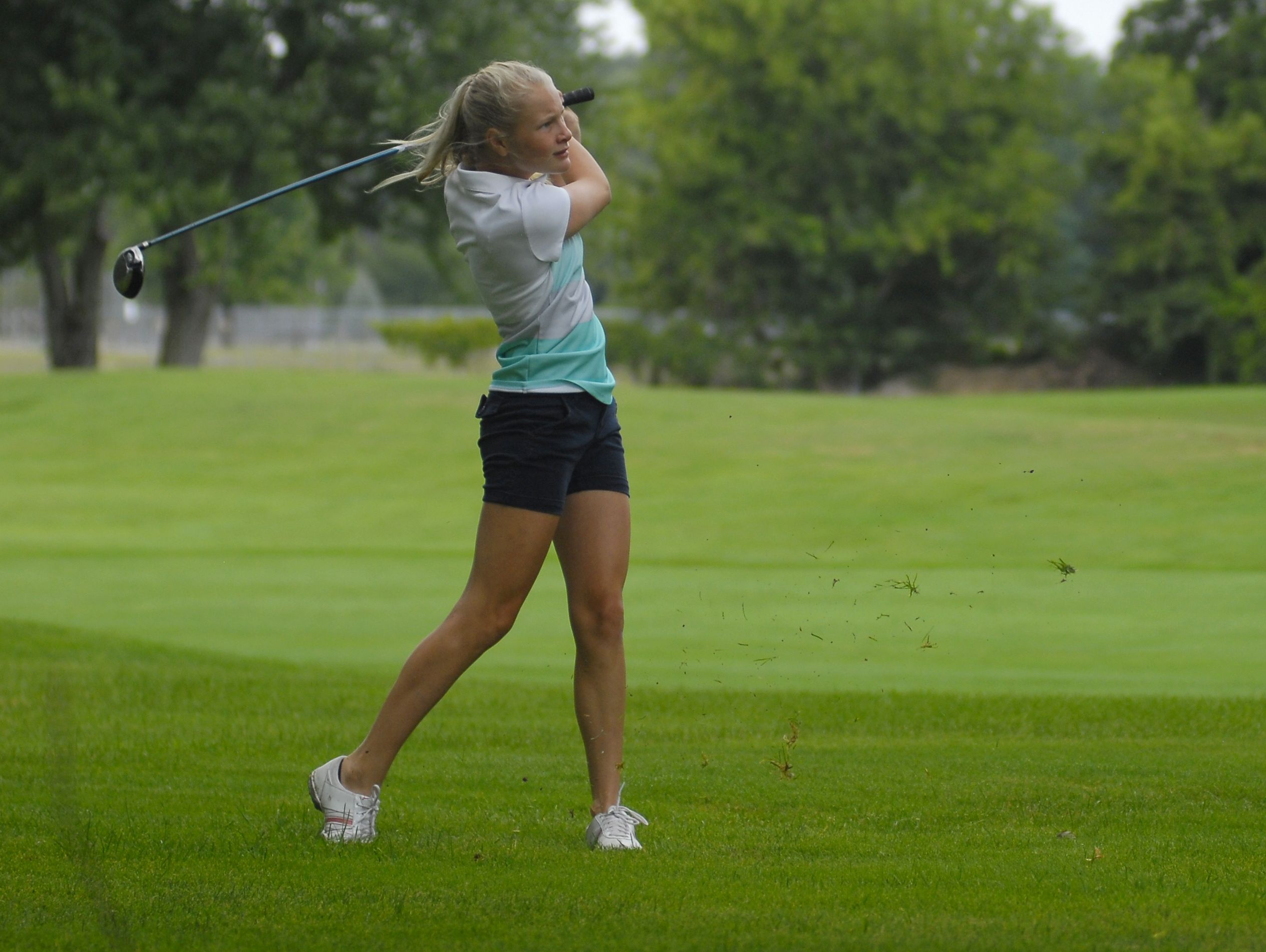 Brandi Kautz of Almont watches her shot Monday, Aug 1, during the Tournament of Champions at the Port Huron Elks Golf Course.