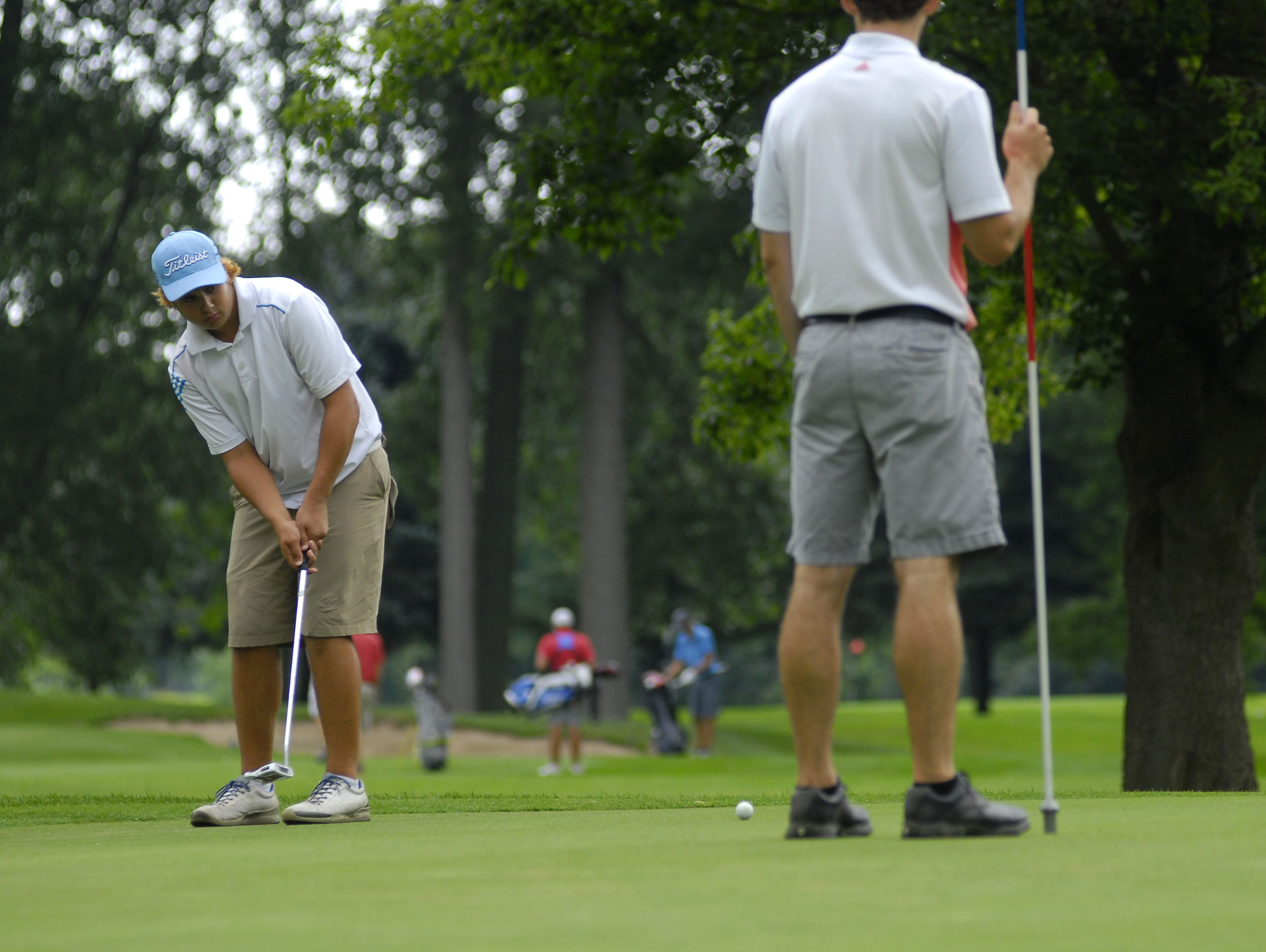 Mitch Bazinski, of Macomb, watches his putt approach the hole Monday, Aug 1, during the Tournament of Champions at the Port Huron Elks Golf Course.