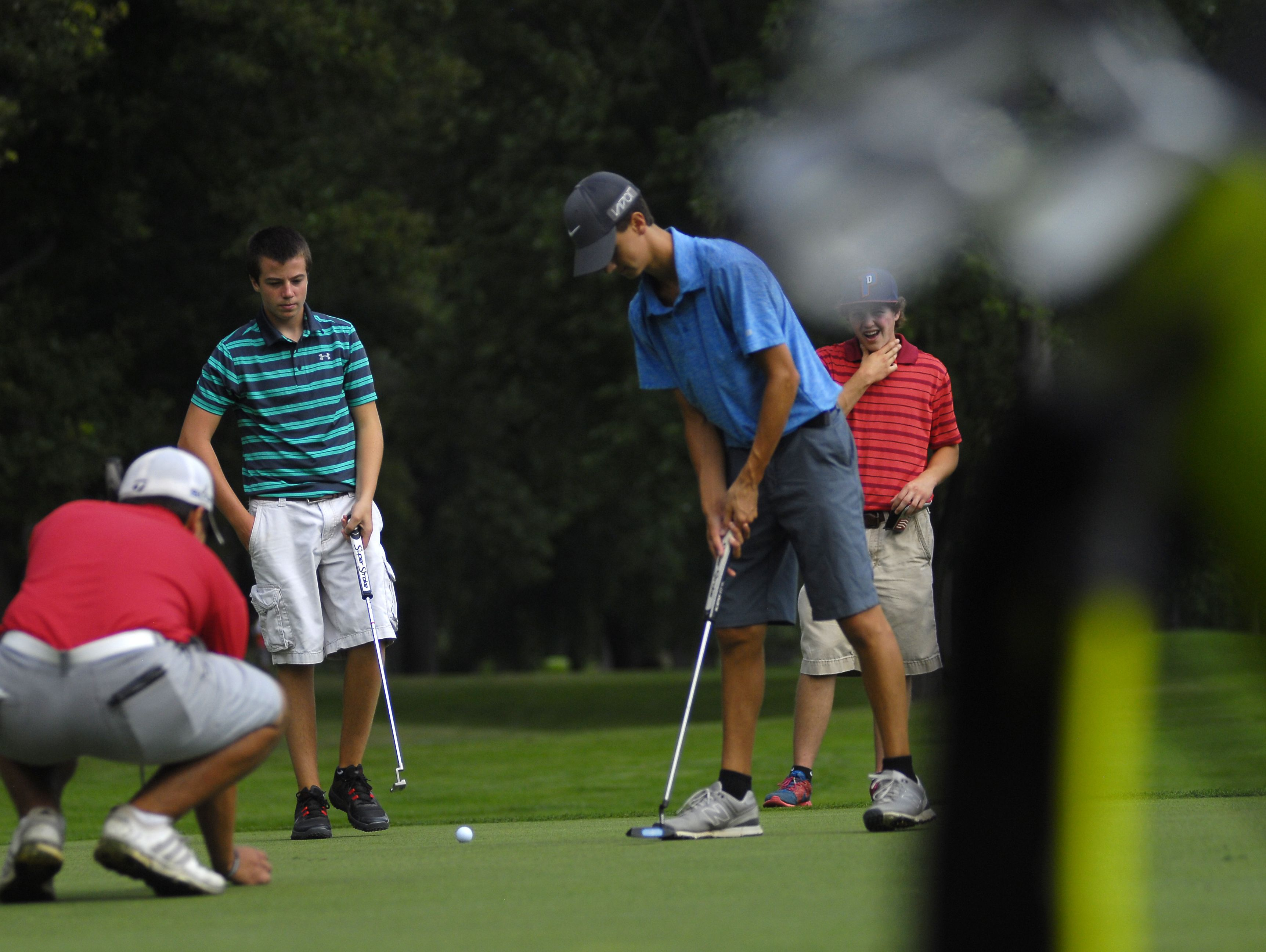 Players work the green Monday, Aug 1, during the Tournament of Champions at the Port Huron Elks Golf Course.