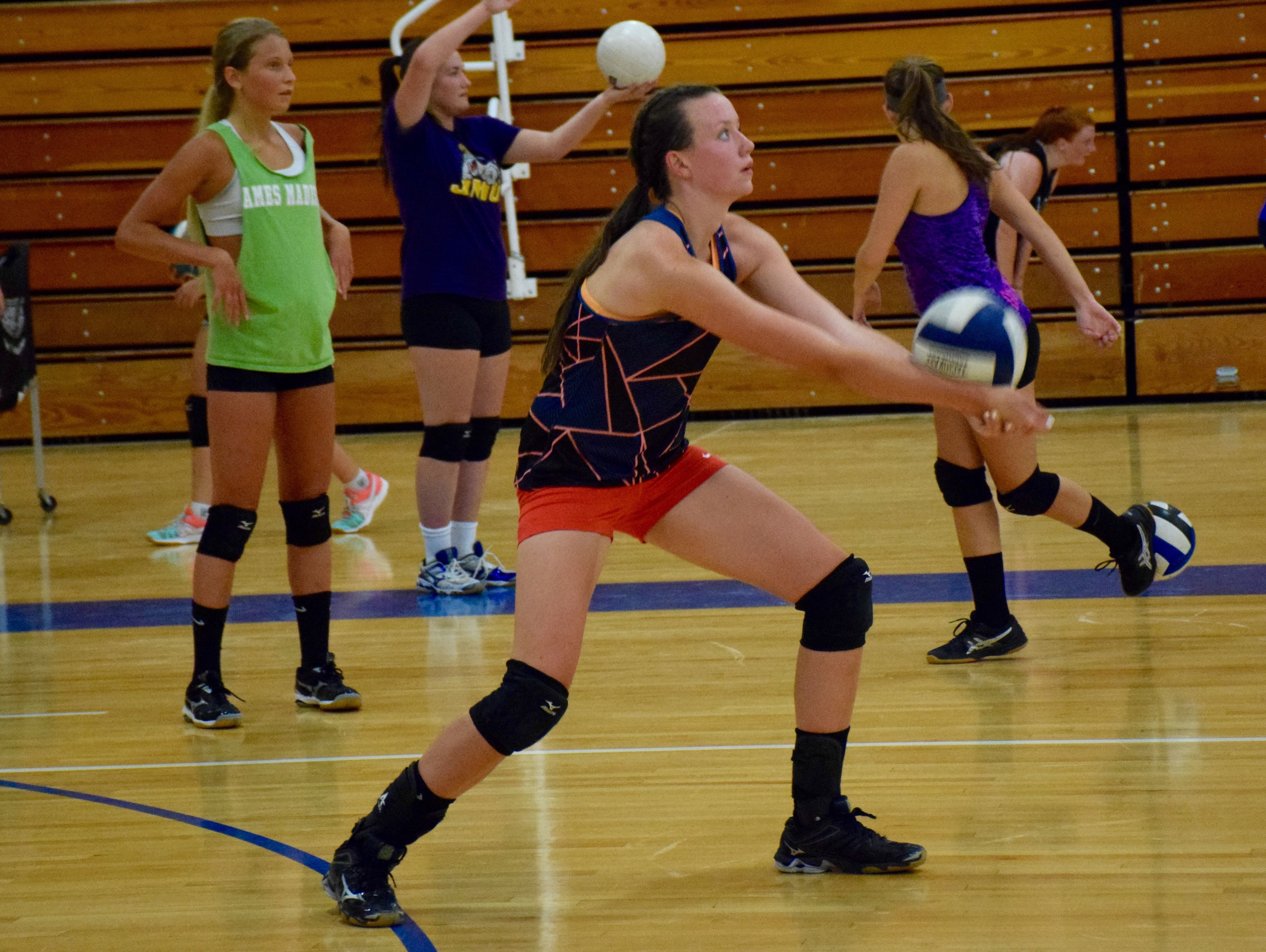 Freshman Nellie Garrison hits return during a drill at the first day of volleyball practice and tryouts for at Robert E. Lee High school on Monday, Aug. 1, 2016, in Staunton.