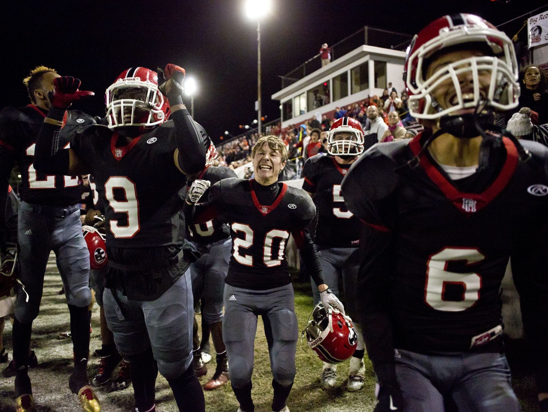 Port Huron players react as they score a touchdown during the Crosstown Showdown Friday, October 23, 2015 at Memorial Stadium in Port Huron.