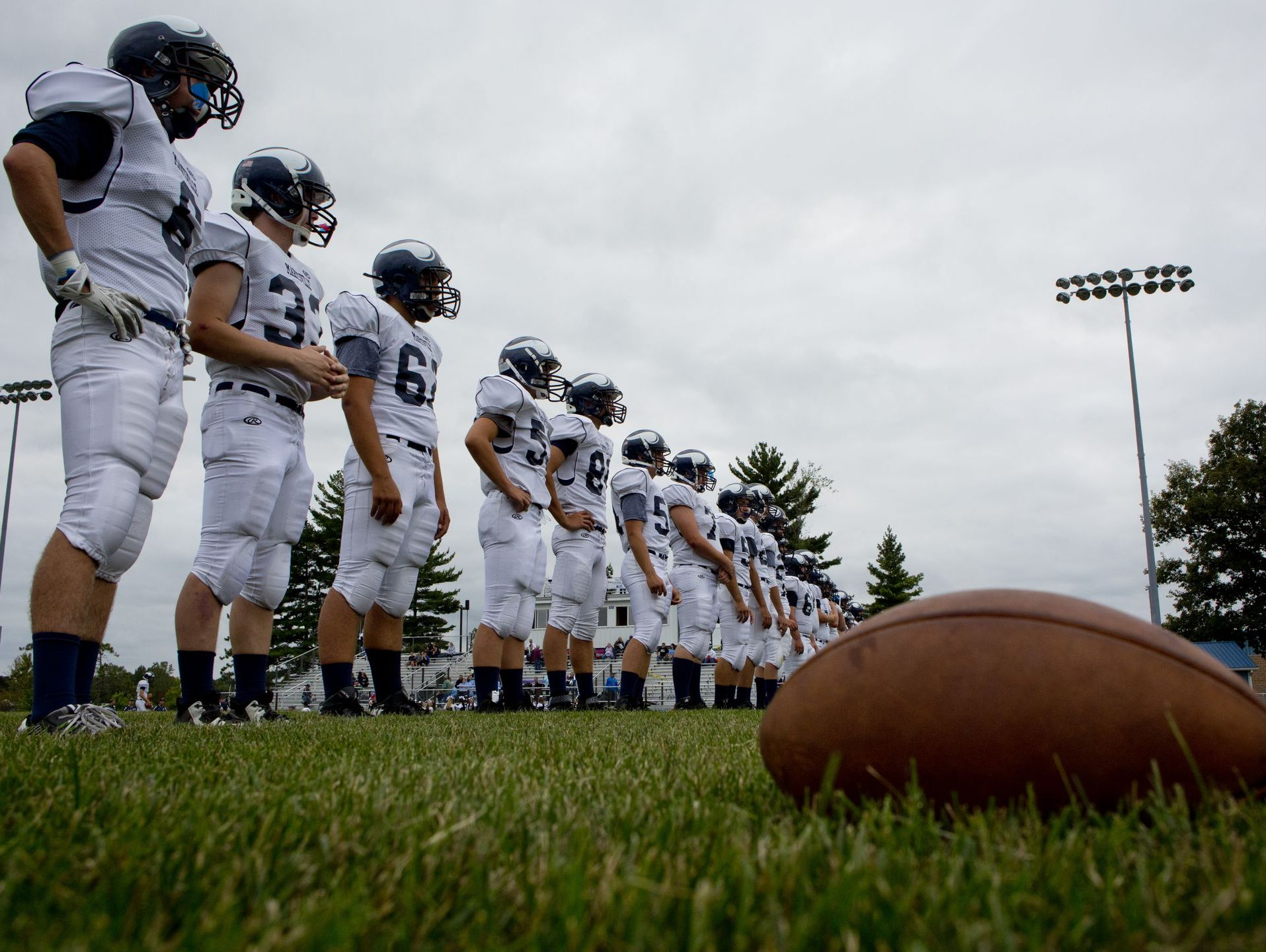 Marysville players line up before a football game Thursday, August 27, 2015 at Richmond High School.
