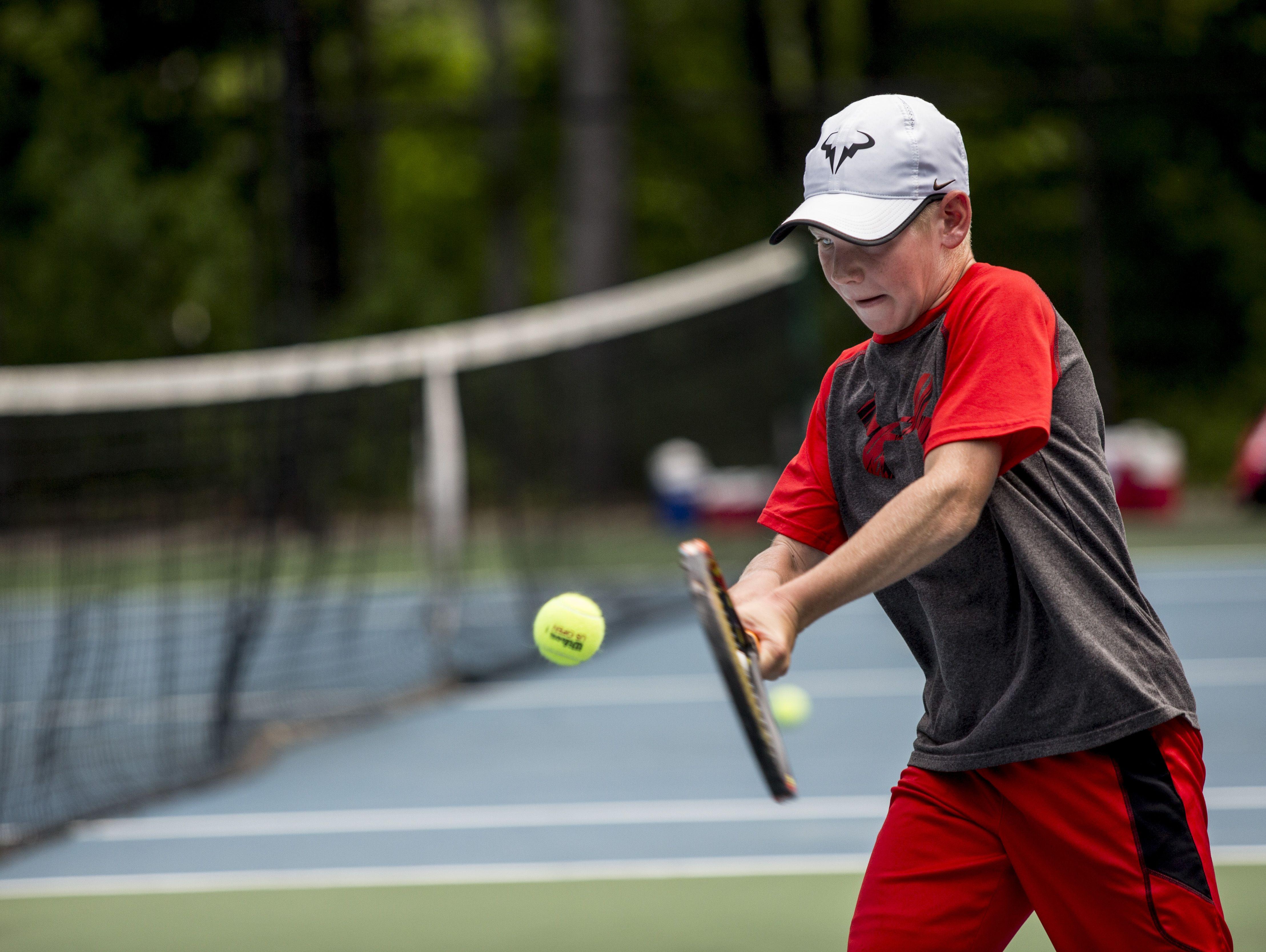 Derek Distelrath, 12, of St. Clair, returns the ball during the Francis J. Robinson Memorial International Tennis Tournament Friday, August 5, 2016 at Sanborn Park in Port Huron.