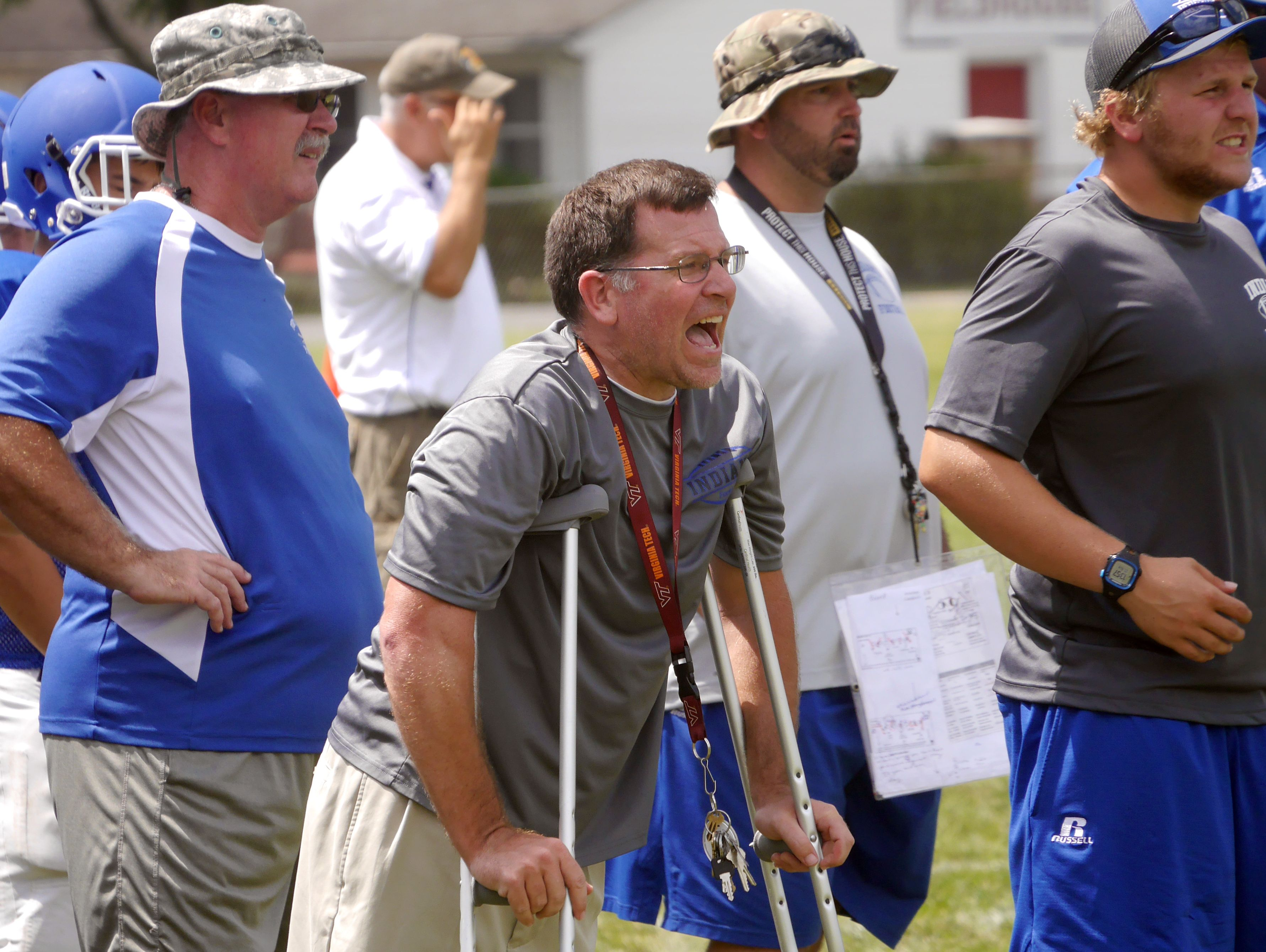 Fort Defiance head coach Dan Rolfe calls out instructions during their scrimmage against James River at the Riverheads High School 2016 football jamboree on Aug. 20, 2016.