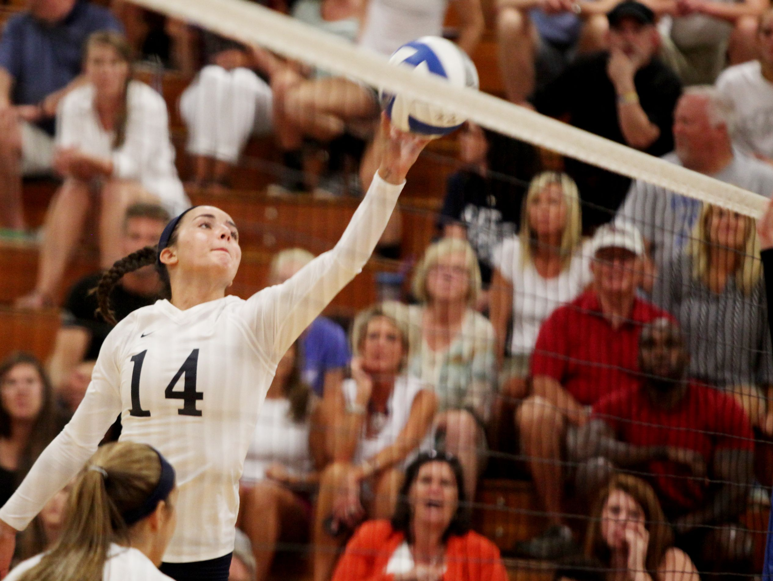 R.E. Lee's MacKensie Bowles taps the ball over the net during Tuesday night's game against Buffalo Gap in Staunton. Lee won in straight sets.