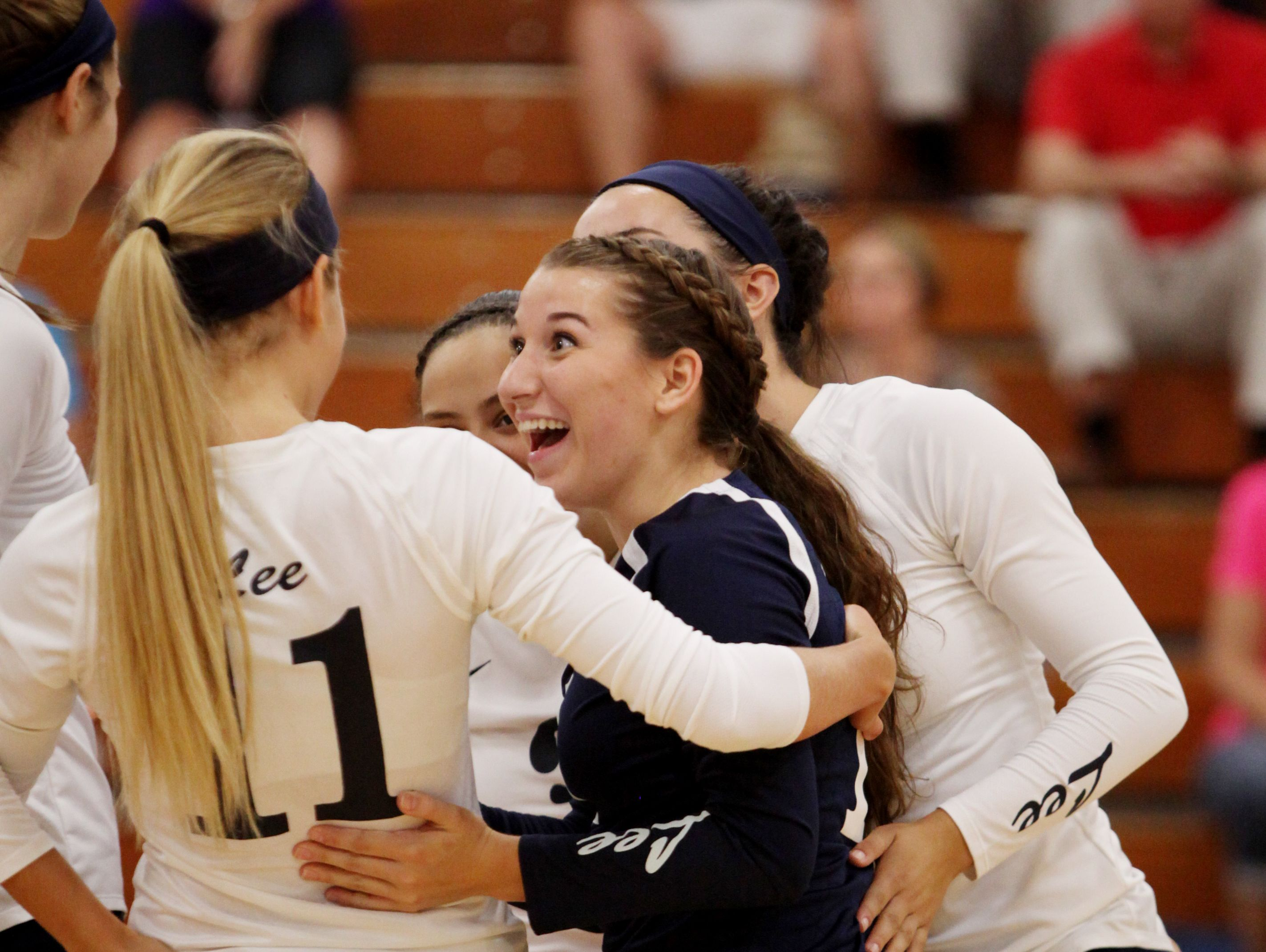 R.E. Lee's Lindsey Bosserman celebrates with teammates after Lee scored a point during Tuesday night's game against Buffalo Gap at R.E. Lee in Staunton on Aug. 30, 2016.