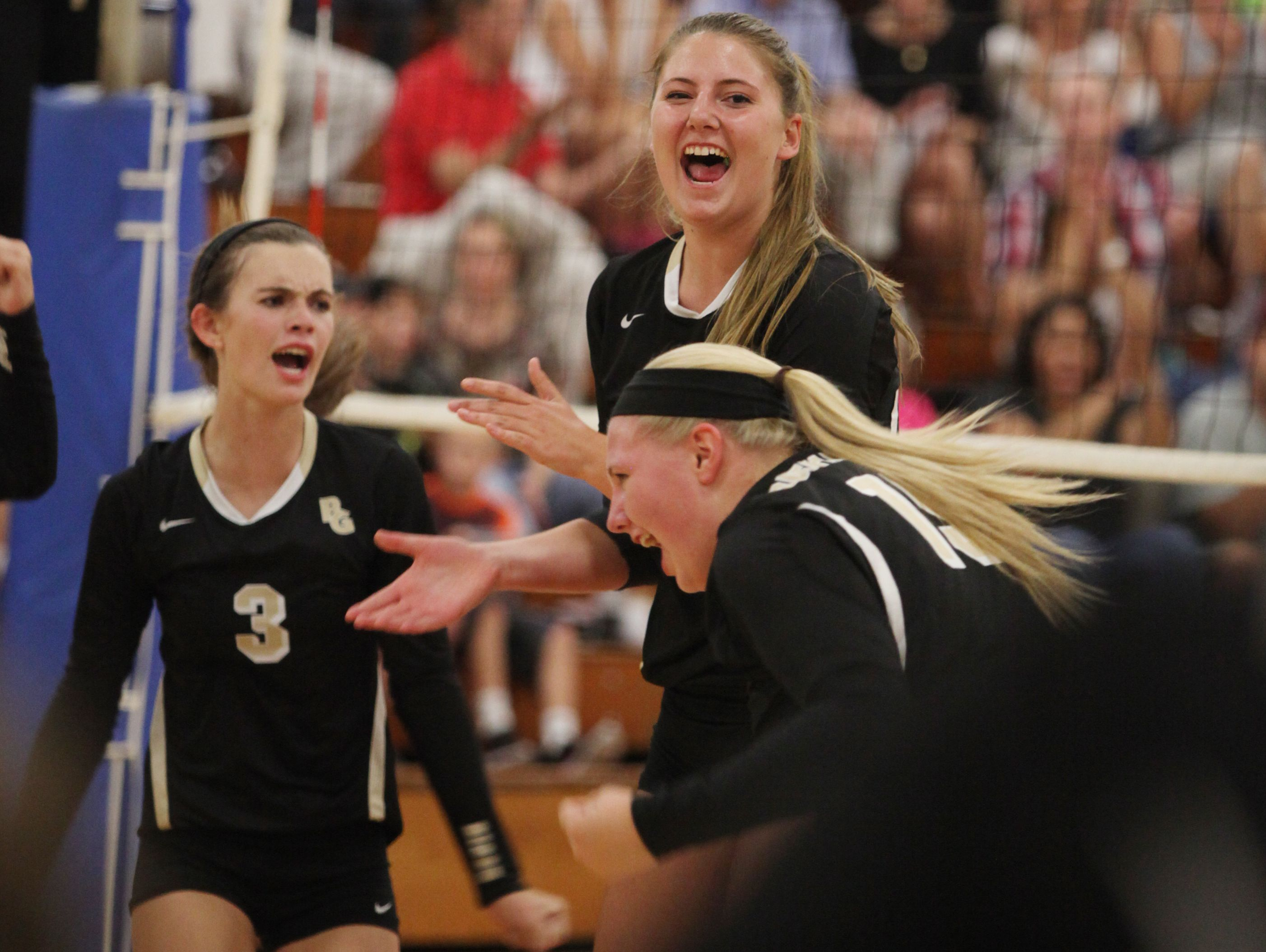 Buffalo Gap's Emily Hanger, center, celebrates with teammates after Gap scored a point during Tuesday night's game at R.E. Lee in Staunton on Aug. 30, 2016.