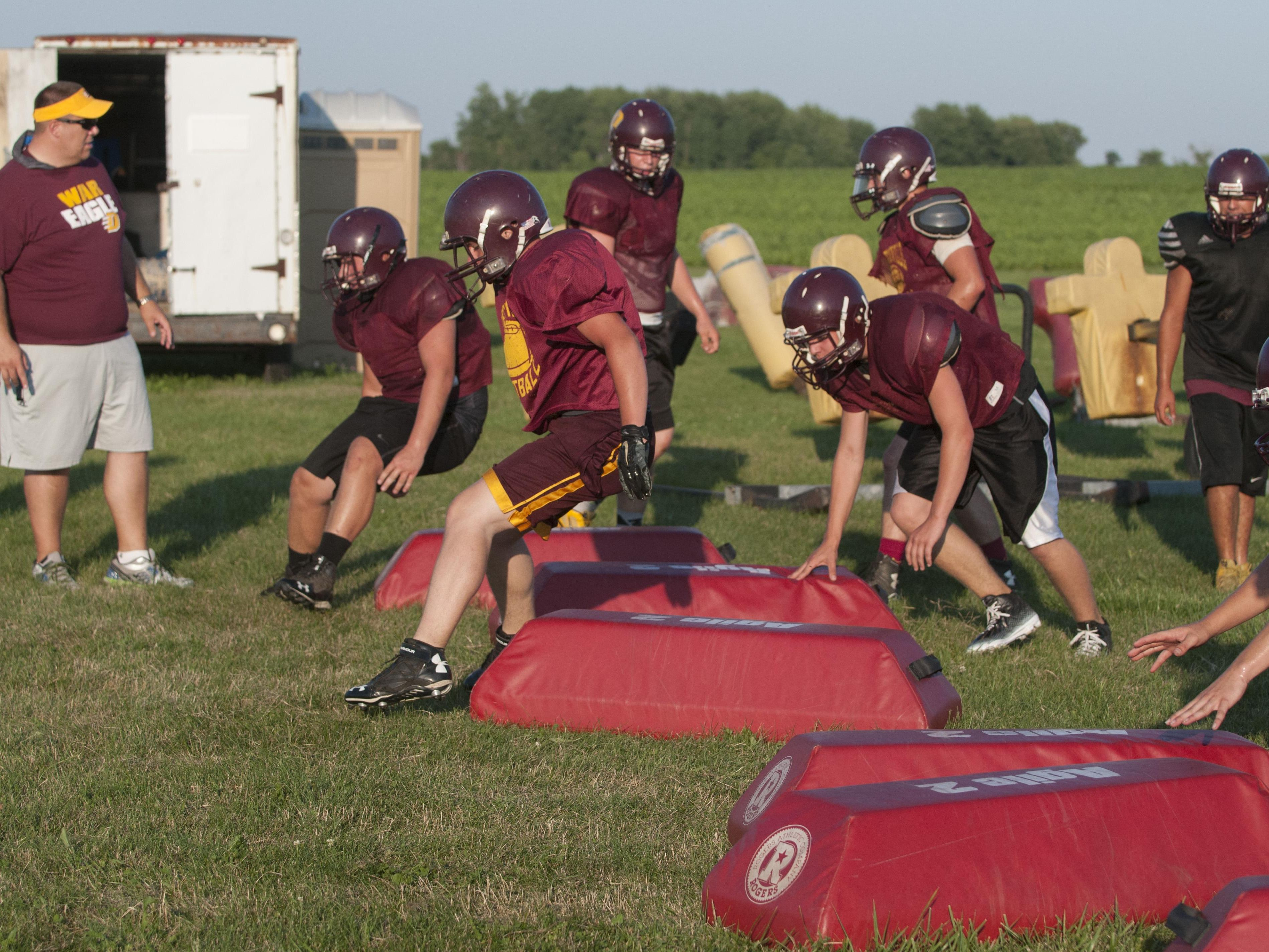 Deckerville's players run through drills Wednesday, Aug. 10, 2016 at Deckerville High School.