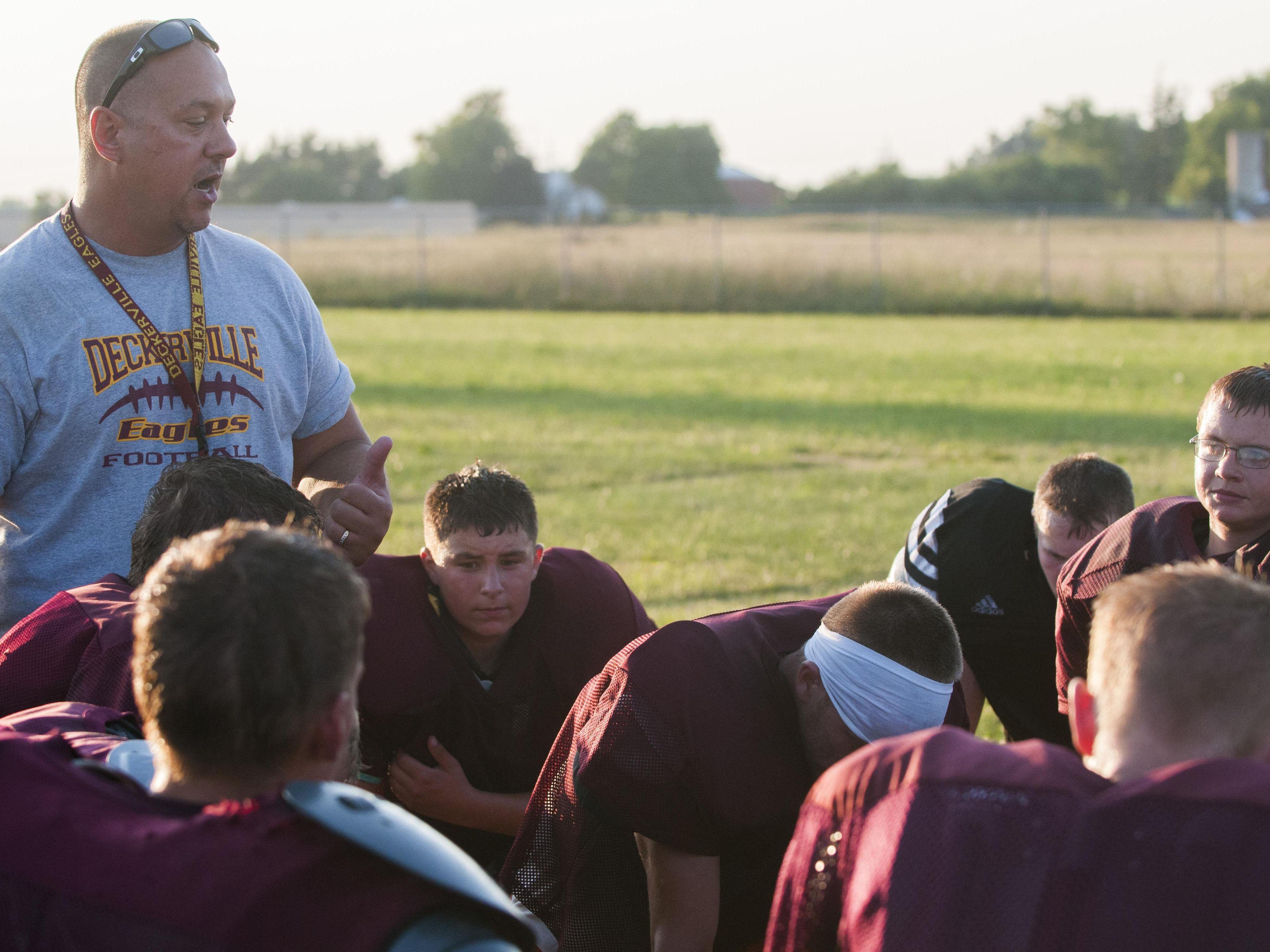 Deckerville Coach Bill Brown talks to his players Wednesday, Aug. 10, 2016 at Deckerville High School.