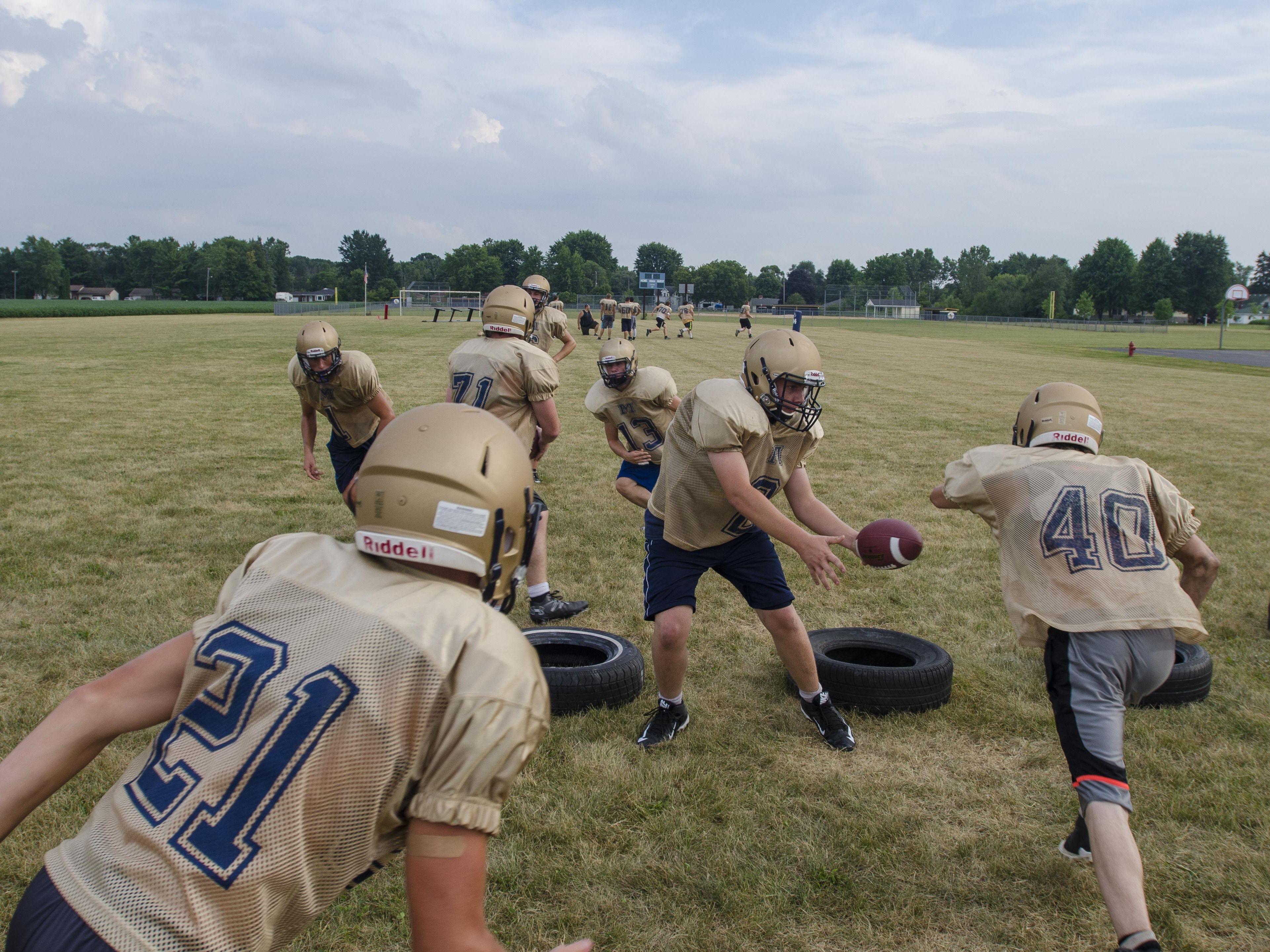 The offense runs through a play Thursday, Aug 11, during practice at Memphis High School.