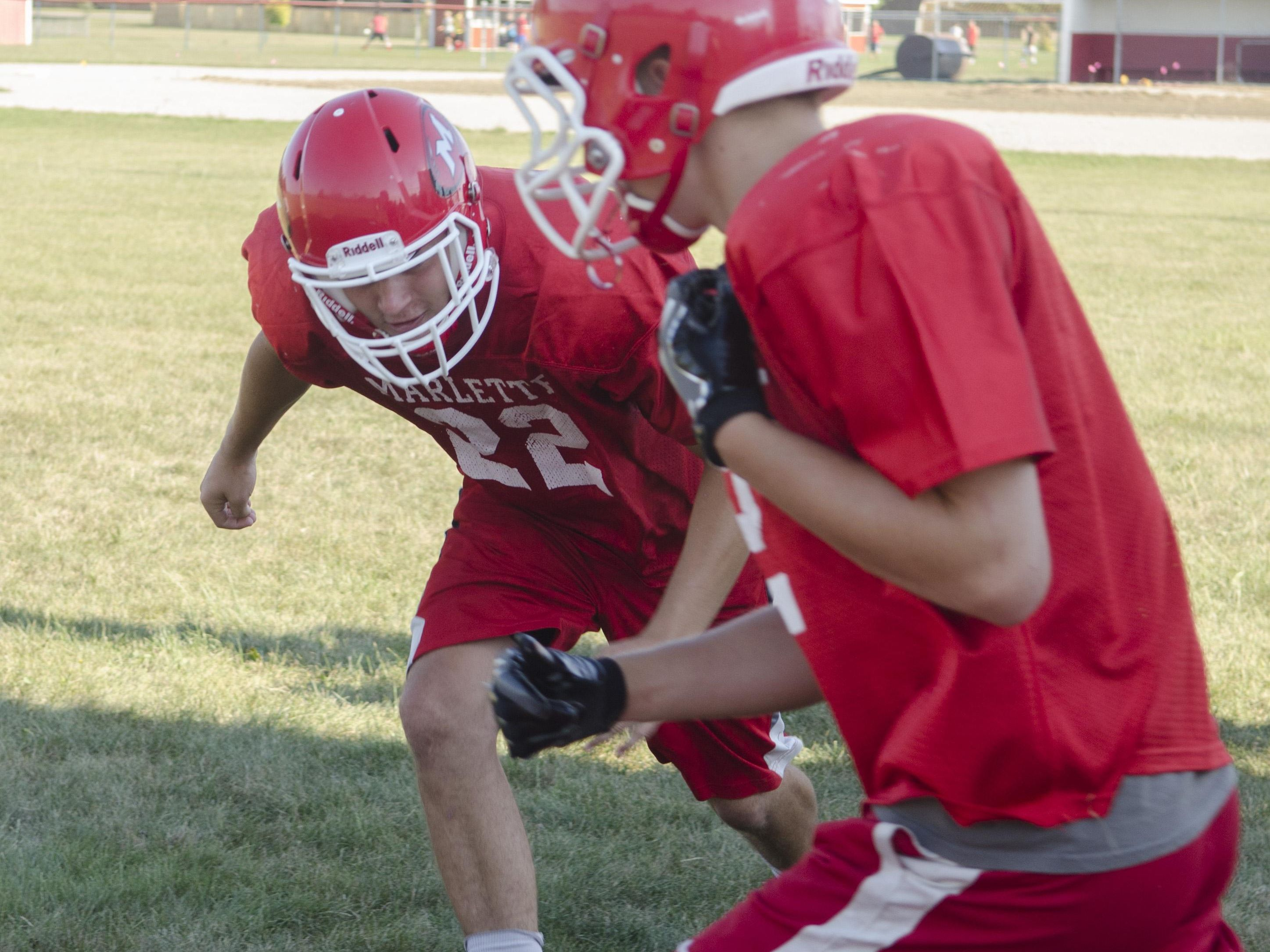 Marlette's Ethan McKenney closes in for a tackle in a tackle drill Wednesday, Aug. 10 , 2016 during their football practice at Marlette High School.