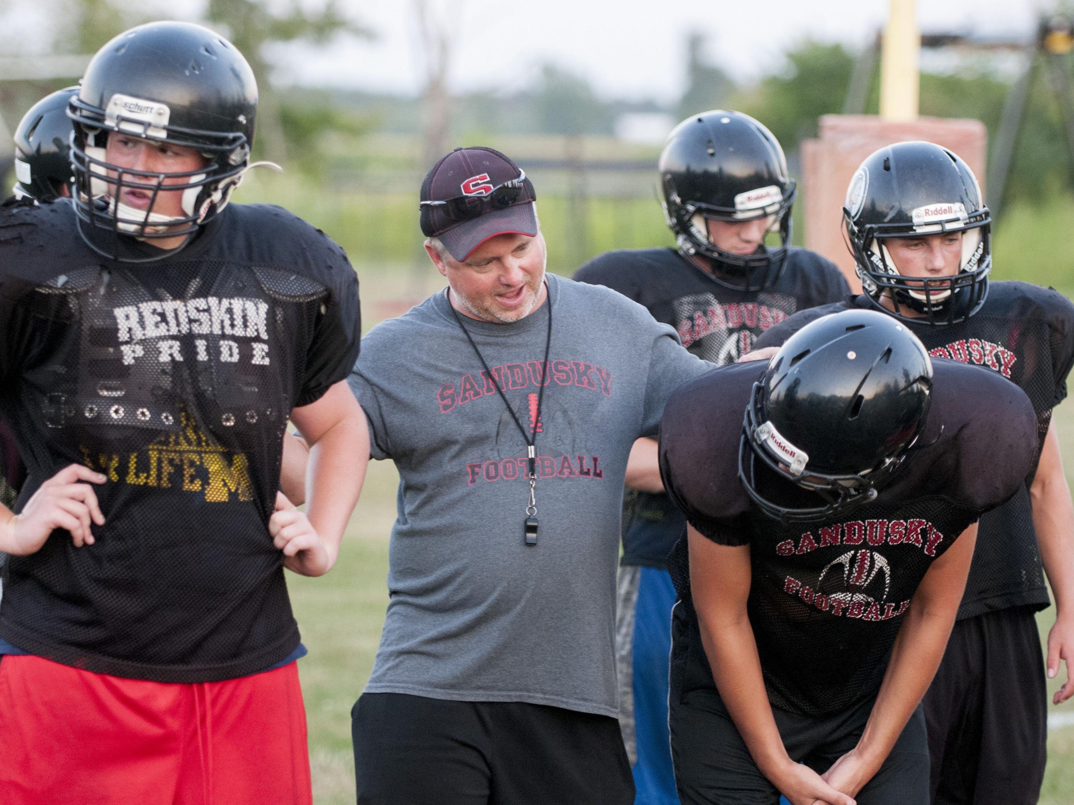 Sandusky Coach Craig Jacobson talks to his players during their practice Wednesday, Aug. 10 2016 at Sandusky High School.