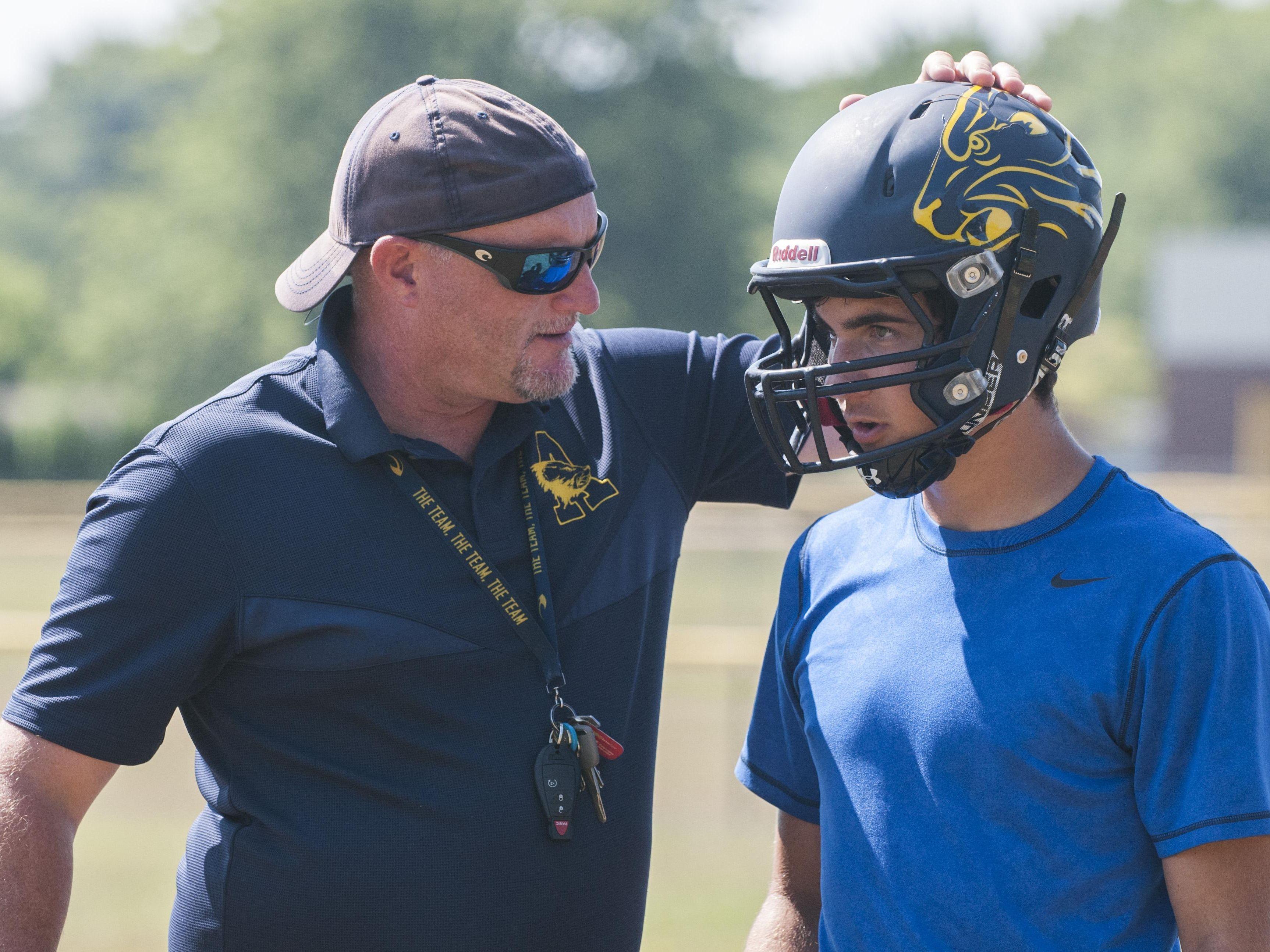 Algonac' coach Scott Barnhart talks to a player Wednesday, Aug. 10 , 2016 during their football practice at Algonac High School.