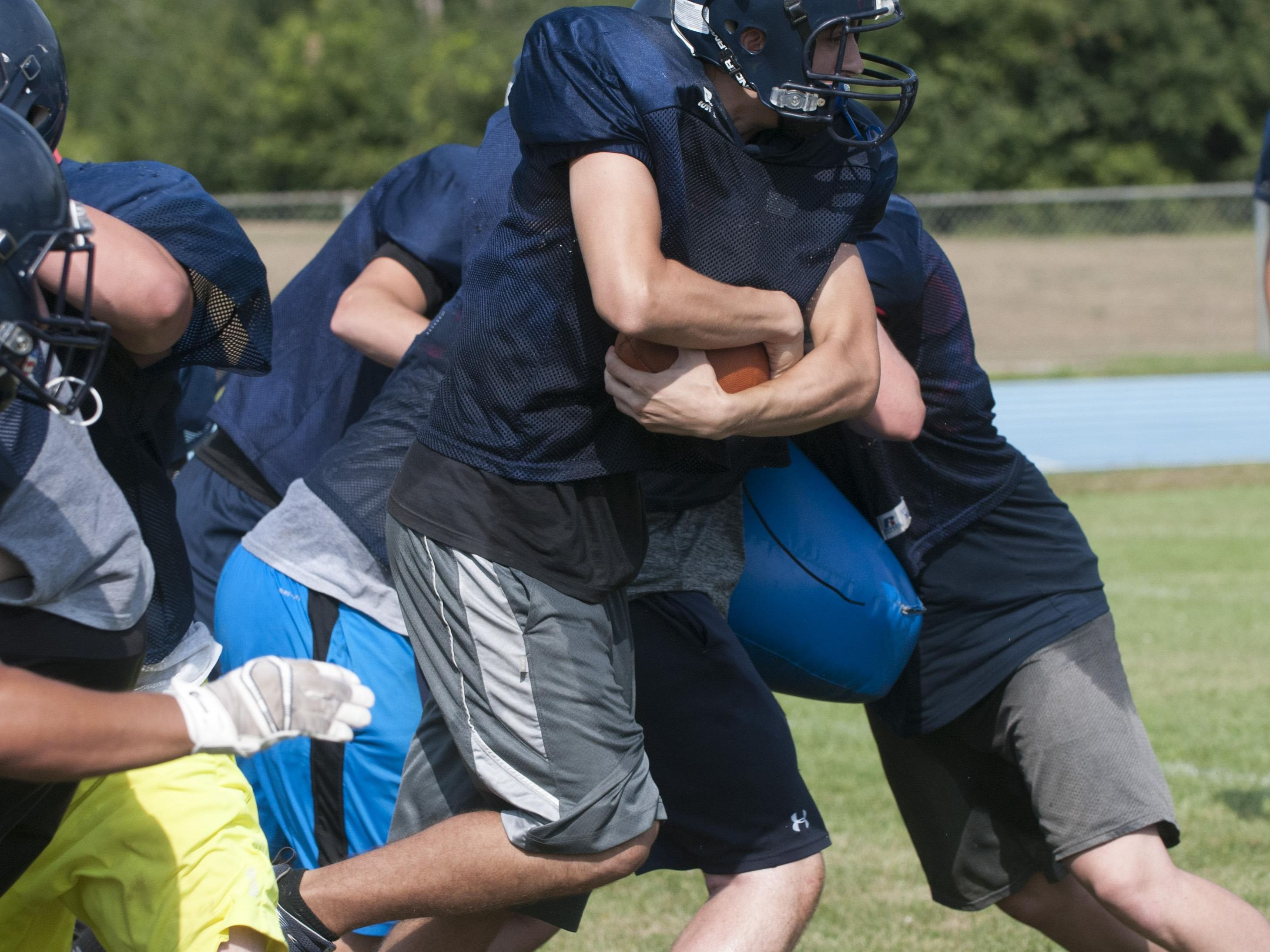 Yale's Andrew Phillips runs the ball Aug. 11 during their football practice at Yale High School.